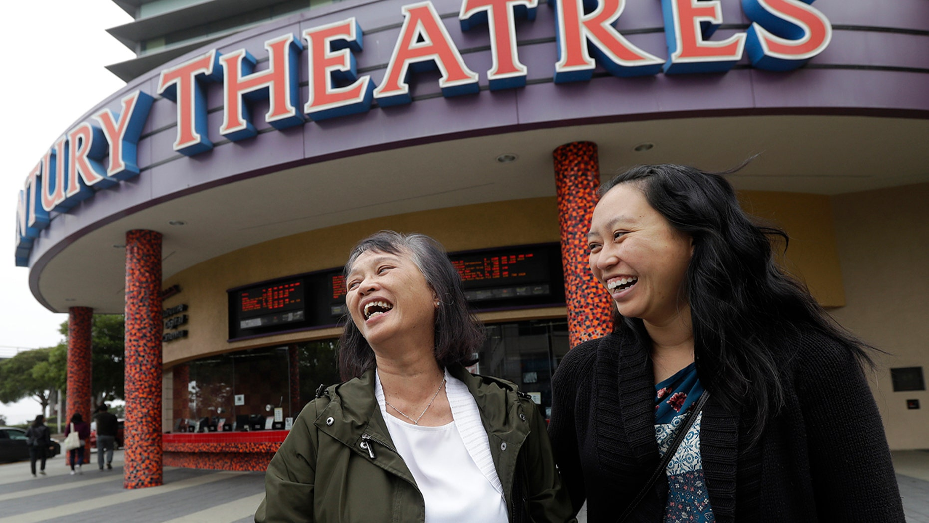 "Alice Sue, left, and her daughter Audrey Sue-Matsumoto laugh while interviewed after watching the movie ""Crazy Rich Asians"" in Daly City, Calif., Aug. 23, 2018."