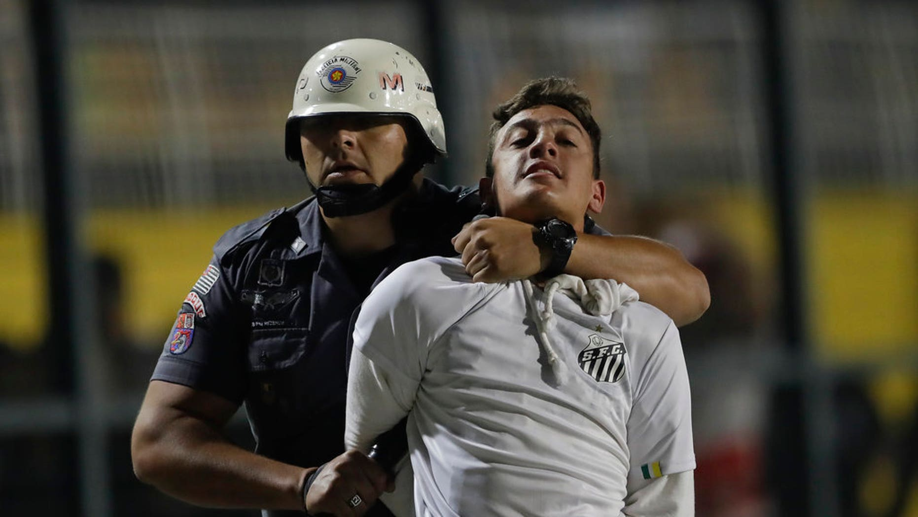 Police clash with soccer fans protesting 3-0 score imposed before match, game abandoned.