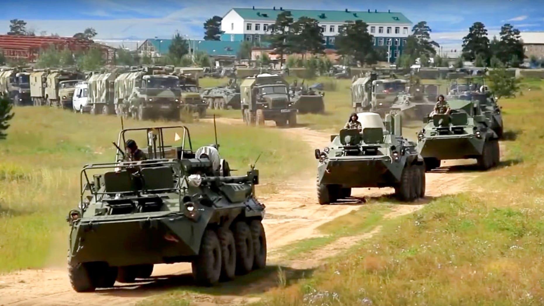 Russian armored personnel carriers roll during the military exercises in the Chita region, Eastern Siberia, during the Vostok 2018 exercises