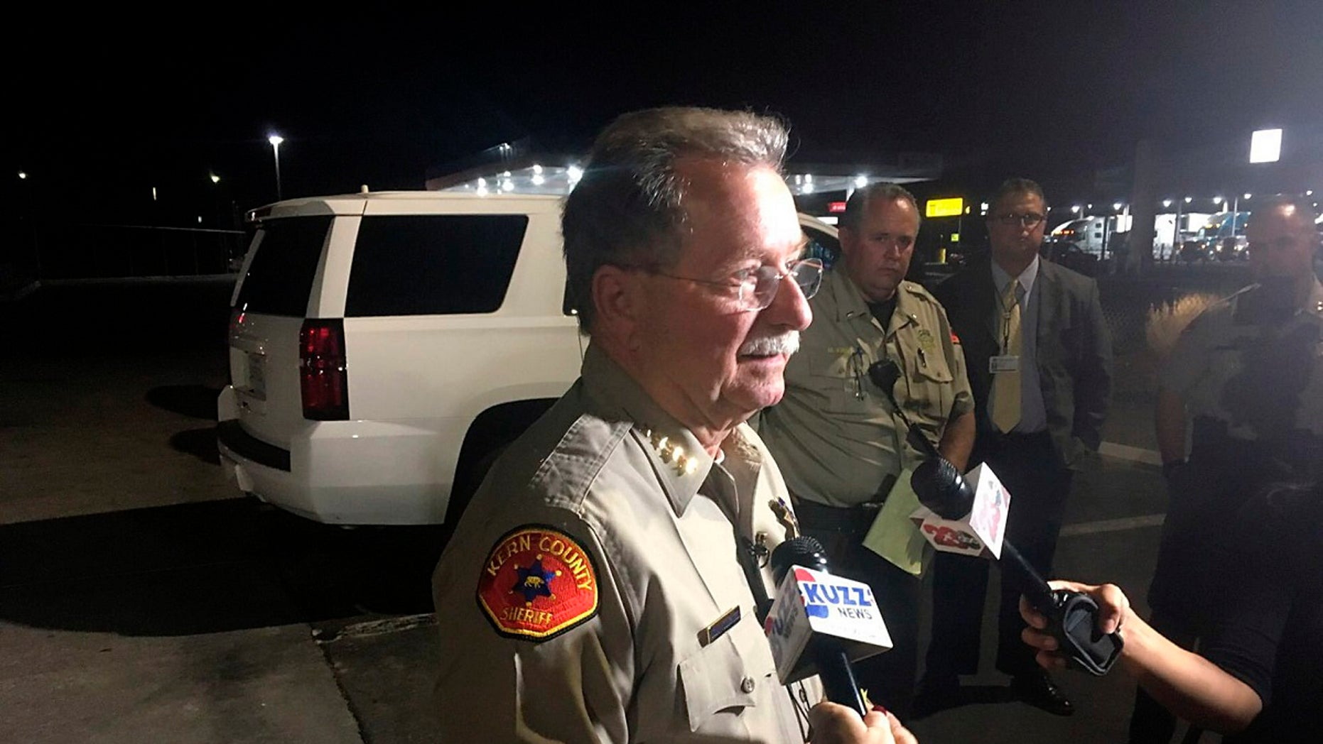 Kern County Sheriff Donny Youngblood talks to the media in southeast Bakersfield, Calif., after authorities said a gunman killed multiple people Wednesday.