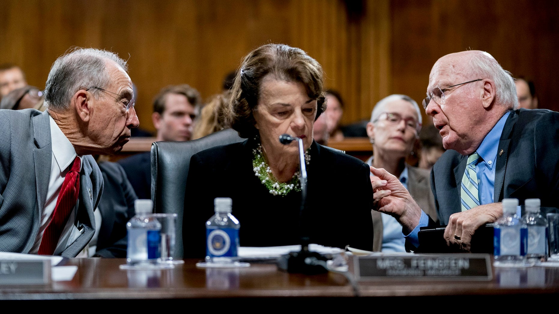 Senate Judiciary Committee Chairman Chuck Grassley (left) confers with other committee members, Sens. Patrick Leahy and Dianne Feinstein, the ranking member.