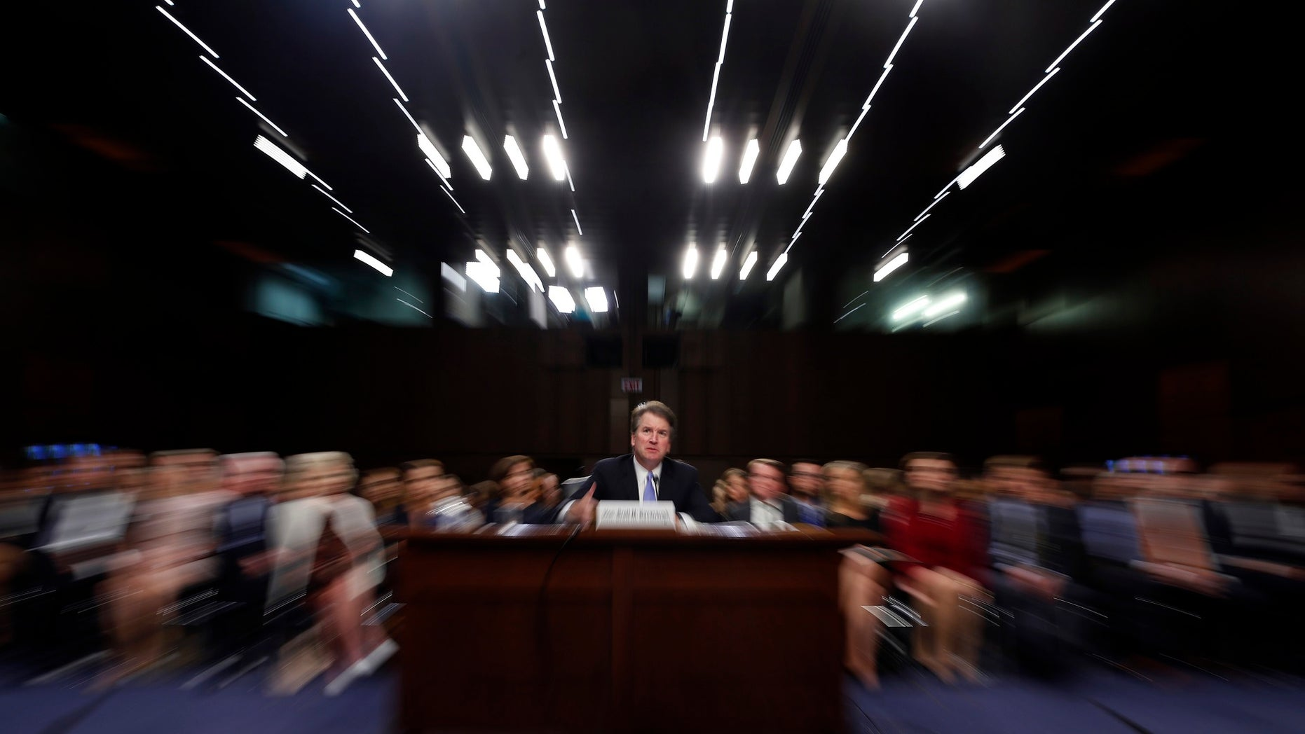 "FILE - In this Thursday, Sept. 6, 2018 file photo made with a slow shutter speed and a zoom lens, President Donald Trump's Supreme Court nominee, Brett Kavanaugh testifies before the Senate Judiciary Committee on Capitol Hill in Washington, for the third day of his confirmation hearing. On Thursday, Sept. 20, 2018, an attorney for Christine Blasey Ford said she would testify to the Senate next week about her accusation that Kavanaugh assaulted her when both were high school students if agreement can be reached to ""terms that are fair and which ensure her safety."" (AP Photo/Alex Brandon)"