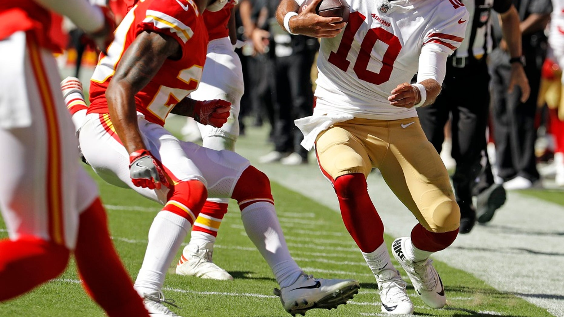 FILE: Kansas City Chiefs defensive back Steven Nelson (20) closes in to tackle San Francisco 49ers quarterback Jimmy Garoppolo (10), right, during the second half of an NFL football game in Kansas City, Mo.