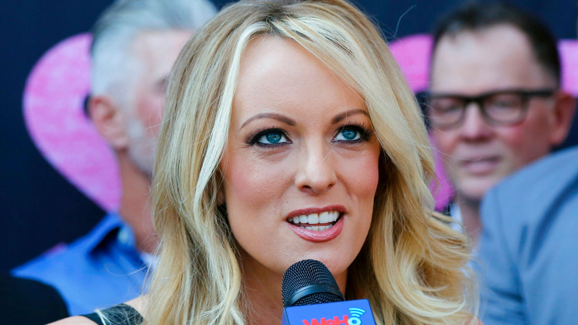 FILE: Adult film actress Stormy Daniels, speaks during a ceremony for her receiving a City Proclamation and Key to the City in West Hollywood, Calif.