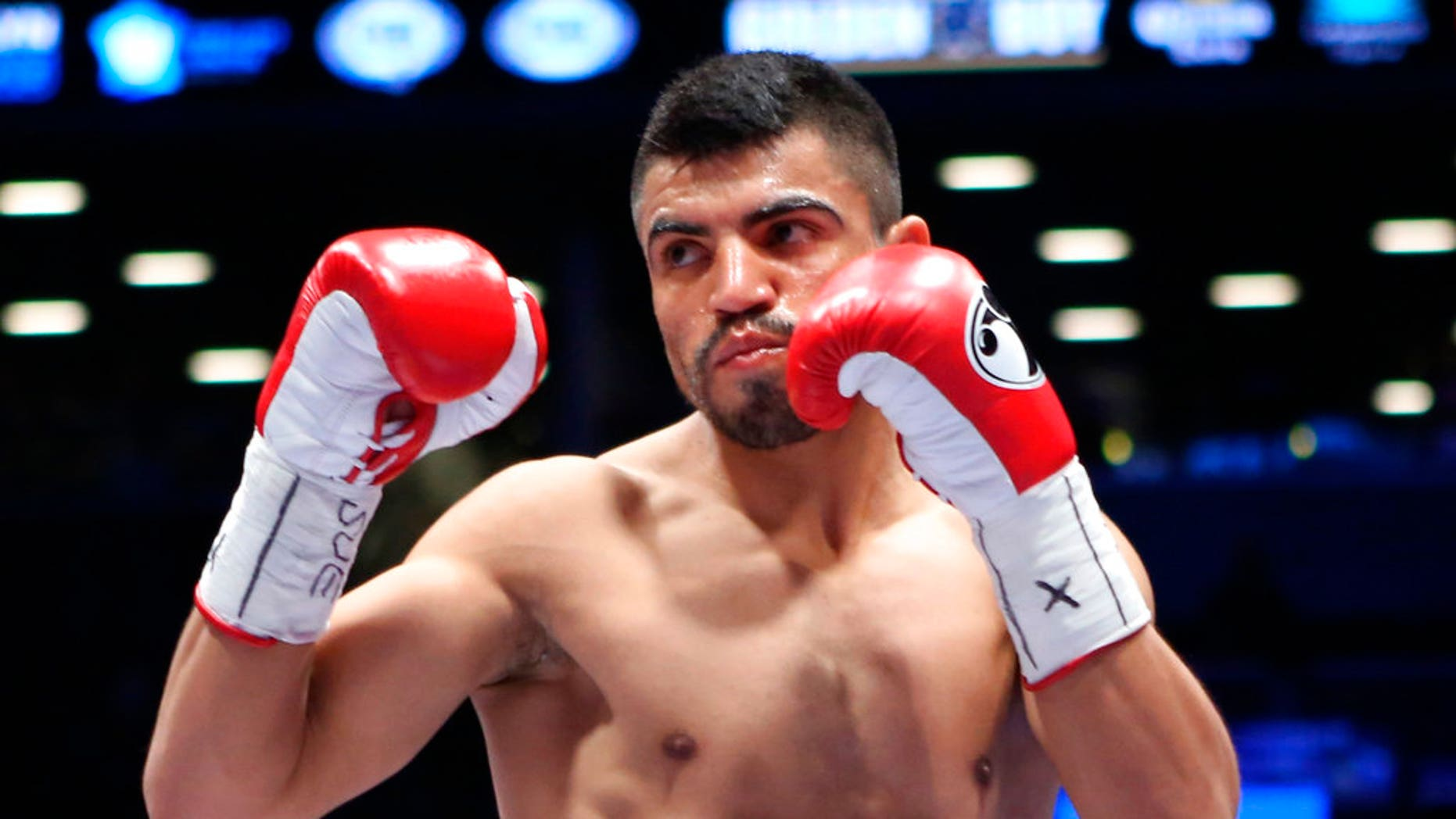 FILE: Victor Ortiz faces Luis Collazo, not seen, in a welterweight boxing bout in the Brooklyn borough of New York.