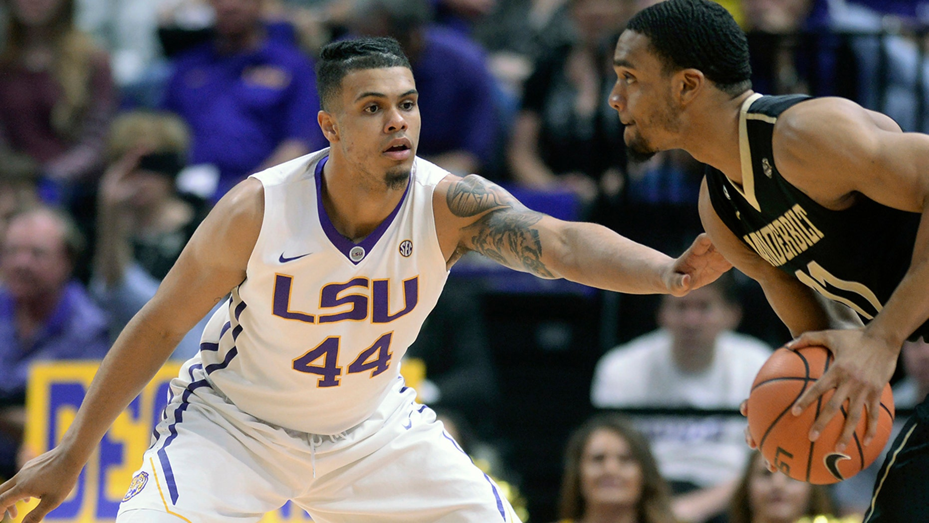 FILE - In this Feb. 20, 2018, file photo, LSU forward Wayde Sims (44) defends against Vanderbilt forward Jeff Roberson (11) during an NCAA college basketball game, in Baton Rouge, La. LSU basketball player Wayde Sims has died after he was shot near the campus of another school in Baton Rouge. Police say in a news release that the 20-year-old Sims was shot around 12:30 a.m. Friday, Sept. 28, 2018, near the campus of Southern University. Sgt. Don Coppola Jr. said Sims was taken to a hospital with an apparent gunshot wound and died. (Hilary Scheinuk/The Advocate via AP, File)