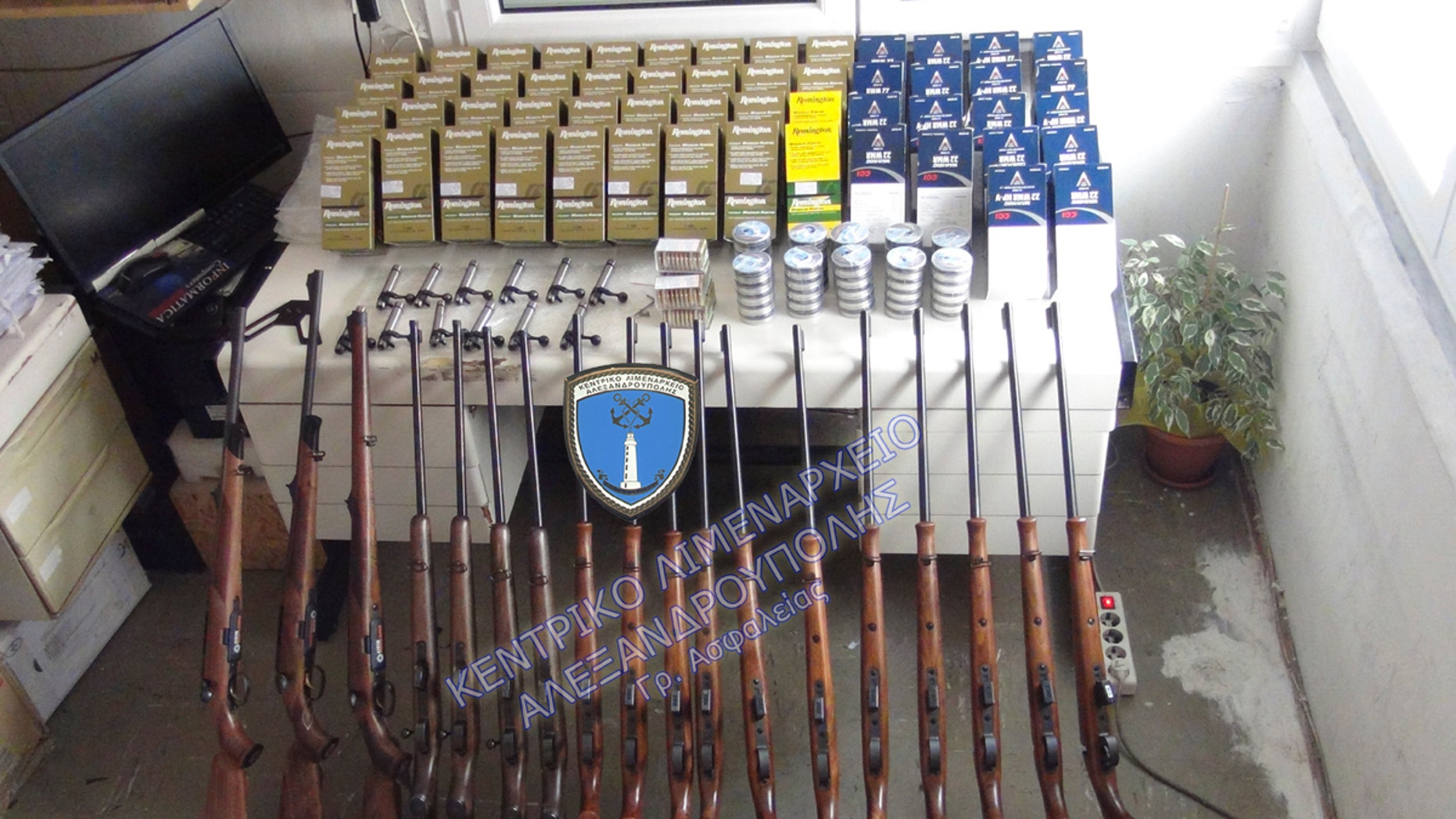 This undated photo shows rifles and bullets confiscated after the arrest of two British citizens in Alexandroupolis. Following this arrest, Greek police say they arrested another man carrying four air rifles, eight scopes and 200,000 bullets.