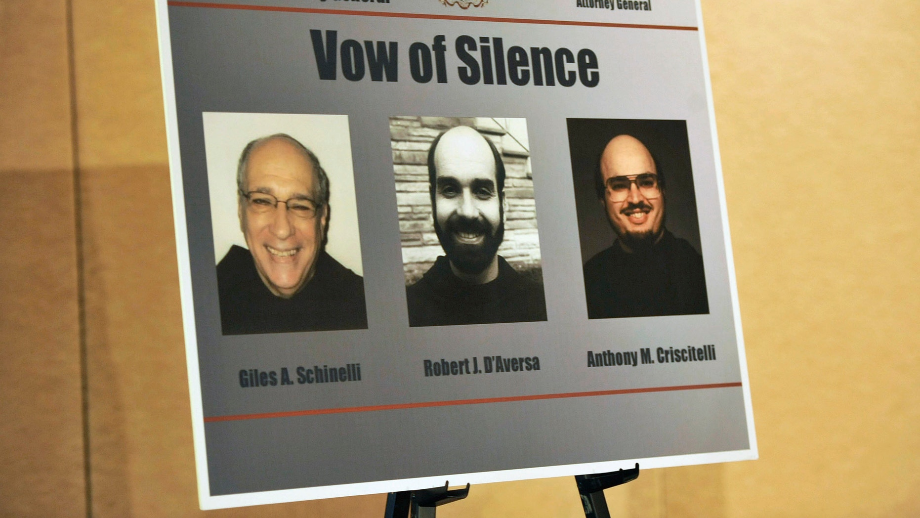 A poster from the Pennsylvania State Attorney General with the images of three ex-leaders of the Franciscan religious order.