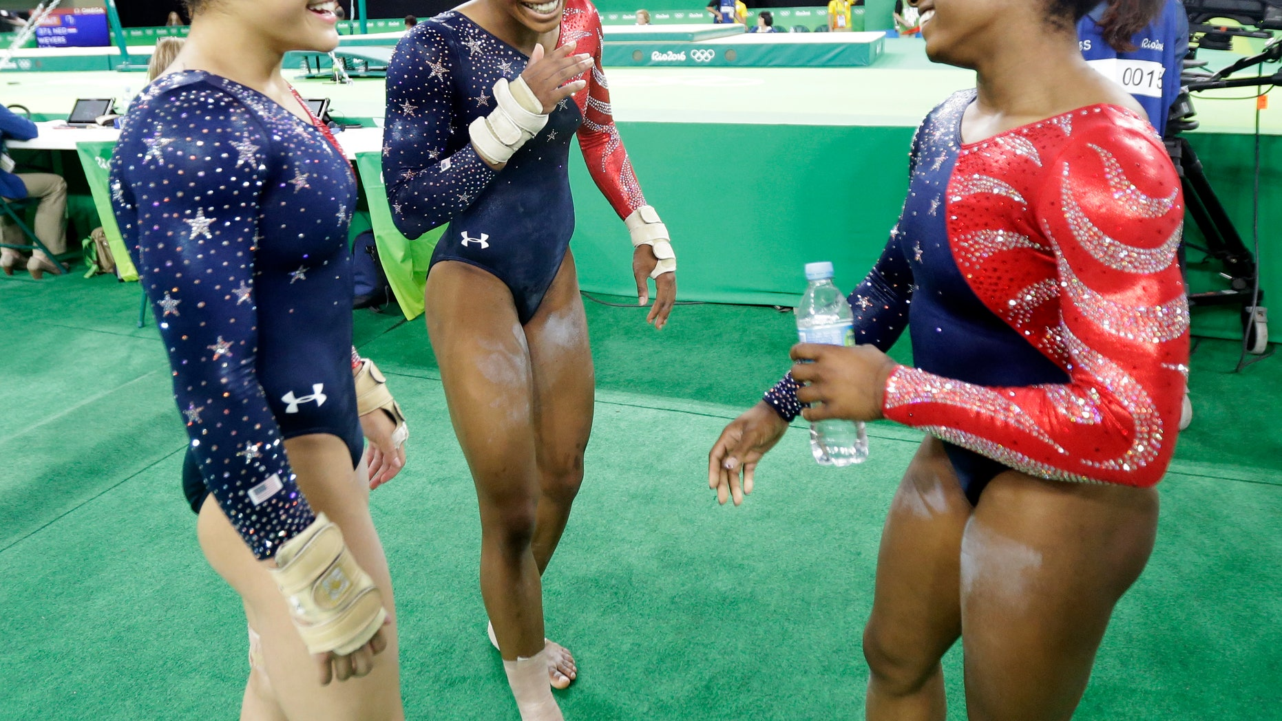 From left, United States' Lauren Hernandez, Gabrielle Douglas and Simone Biles after their floor routine during the artistic gymnastics women's qualification at the 2016 Summer Olympics in Rio de Janeiro, Brazil, Sunday.