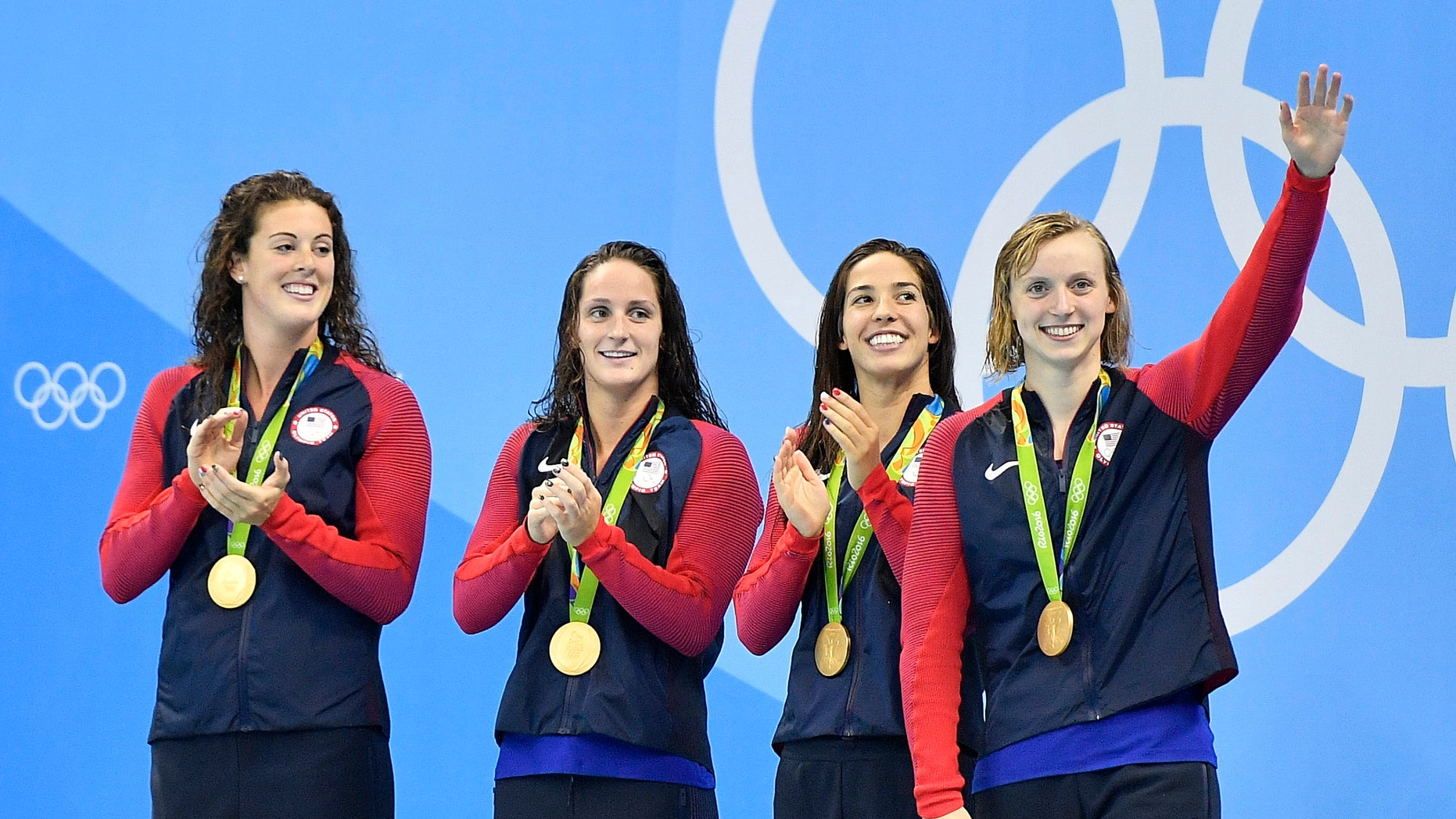 Allison Schmitt, Leah Smith, Maya DiRado and Katie Ledecky, from left, celebrate their gold medals in the women's 4 x 200-meter freestyle relay.