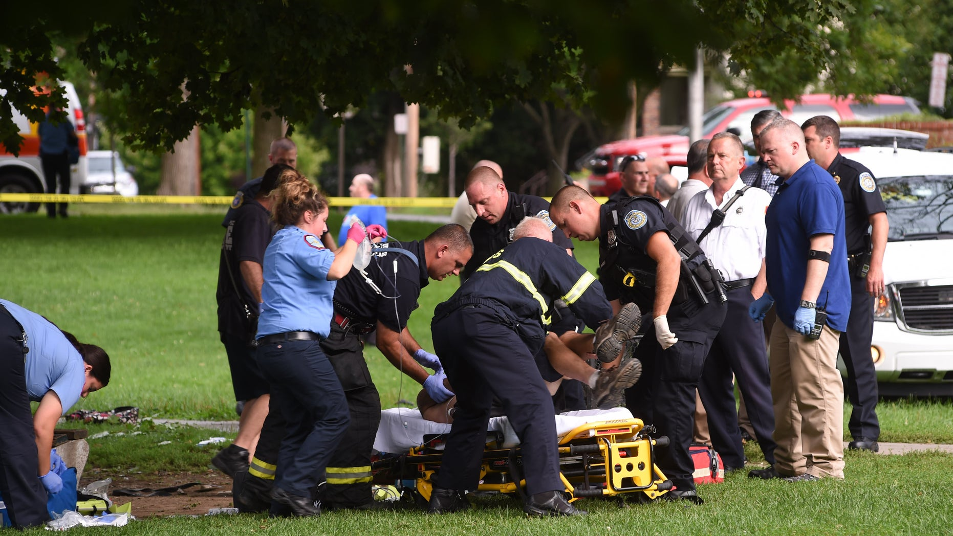 Emergency personnel at Mansion Square Park in Poughkeepsie on Friday.