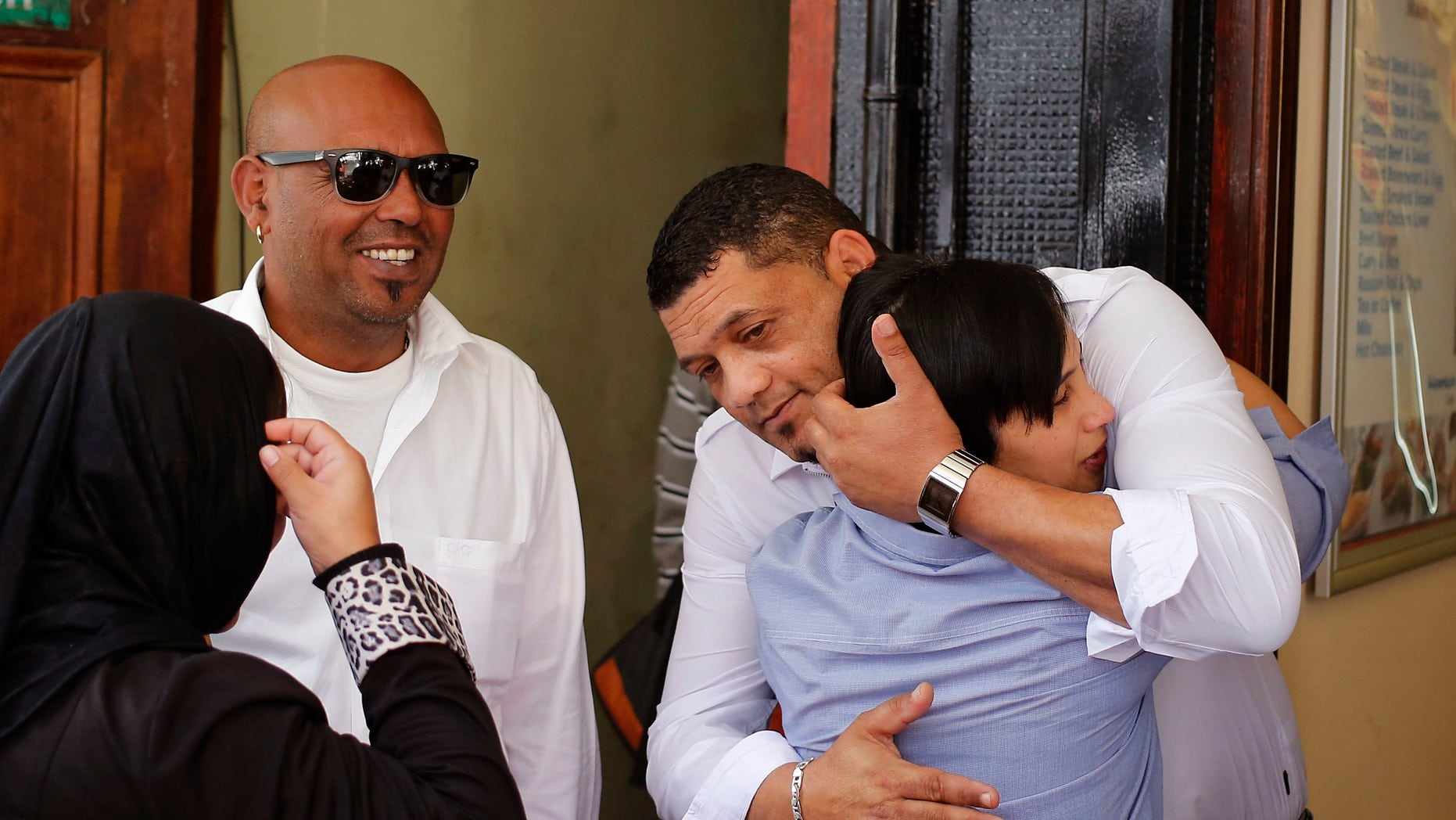Morne and Celeste Nurse, right, the biological parents of the kidnapped child Zephany Nurse, embrace each other after court proceedings in Cape Town, South Africa.
