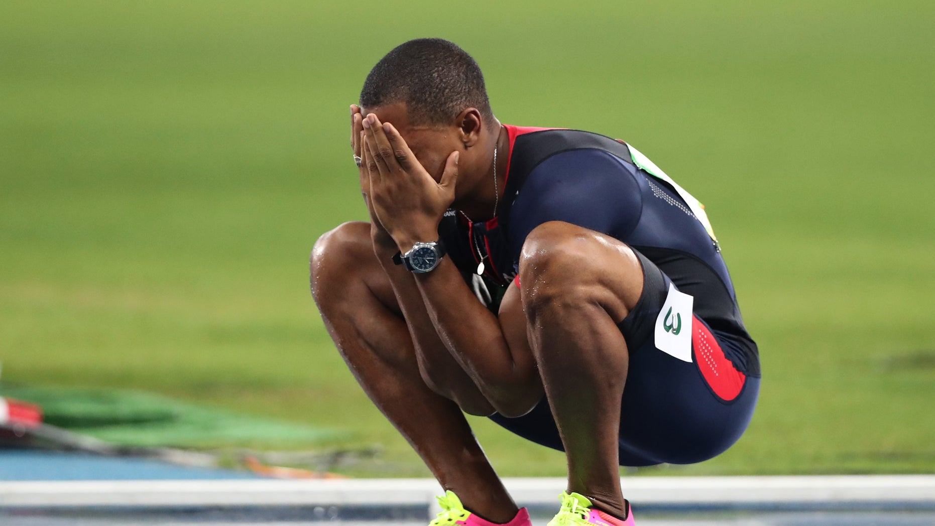 France's Wilhem Belocian reacts after being disqualified for a false start during the athletics competitions of the 2016 Summer Olympics at the Olympic stadium in Rio de Janeiro, Brazil, Monday, Aug. 15, 2016. (AP Photo/Lee Jin-man)