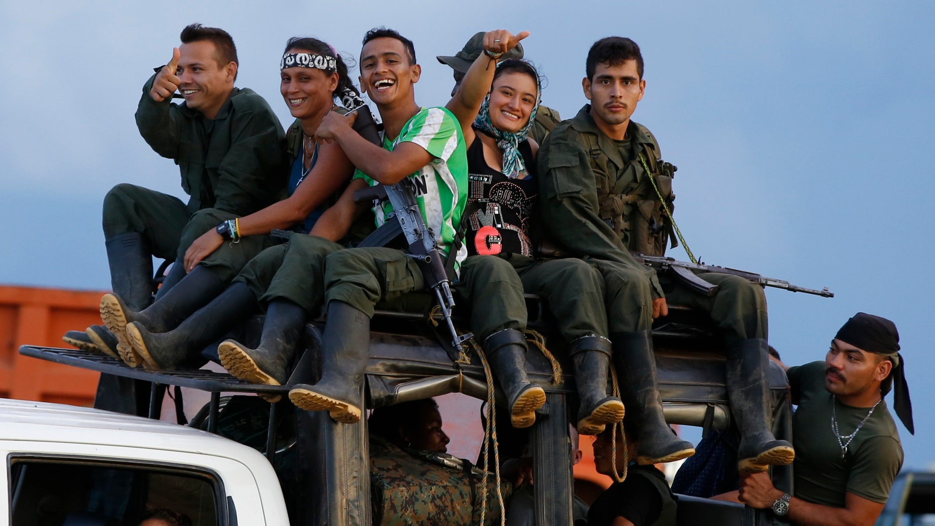 Rebels of the Revolutionary Armed Forces of Colombia (FARC) arrive to El Diamante in southern Colombia, Friday, Sept. 16, 2016. FARC rebels are gathering for a congress to discuss and vote on a peace accord reached with the Colombian government to end five decades of war.
