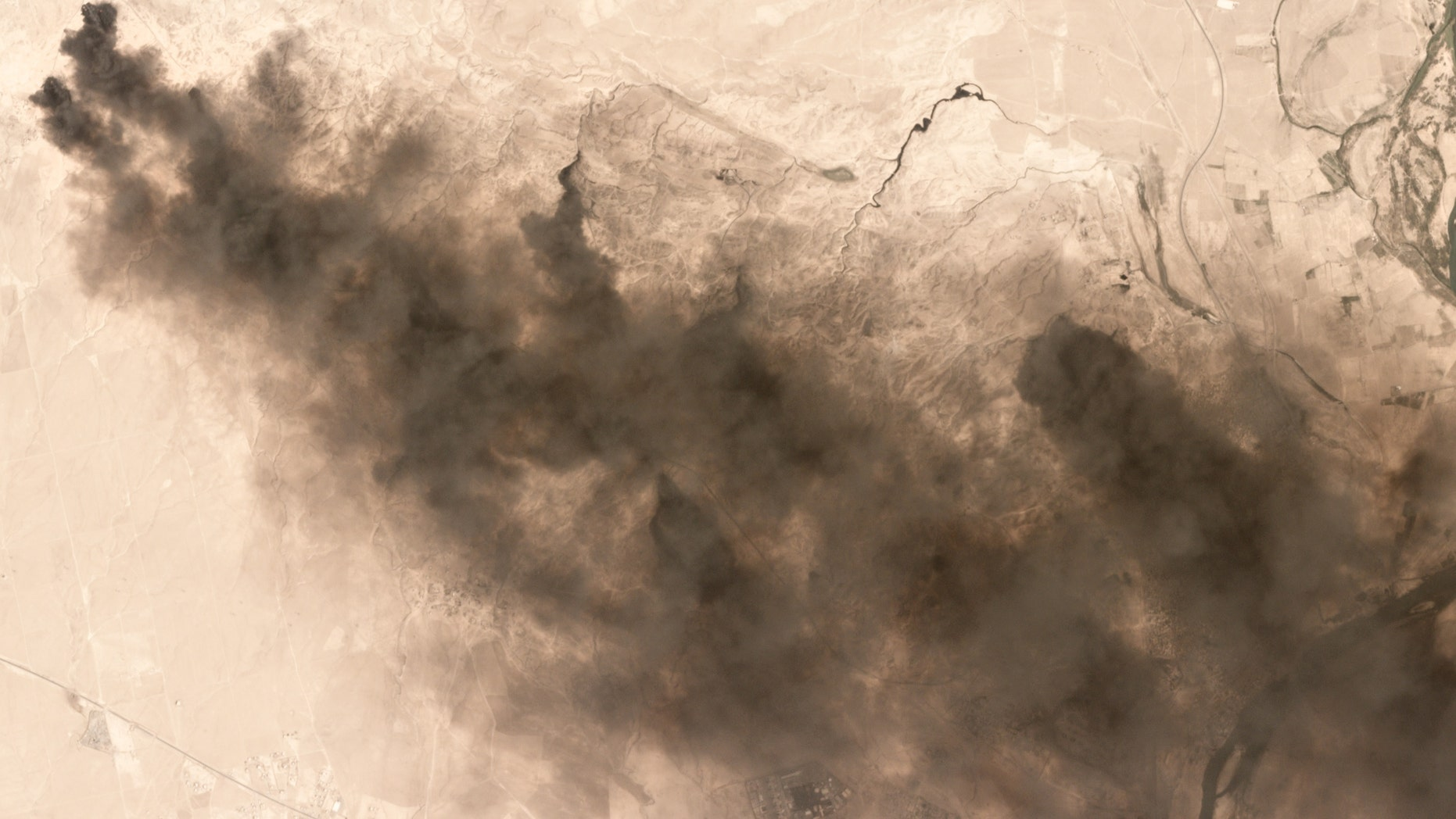 Burning oil fields seen near Qayyarah, Iraq, in this Sept. 4 image.