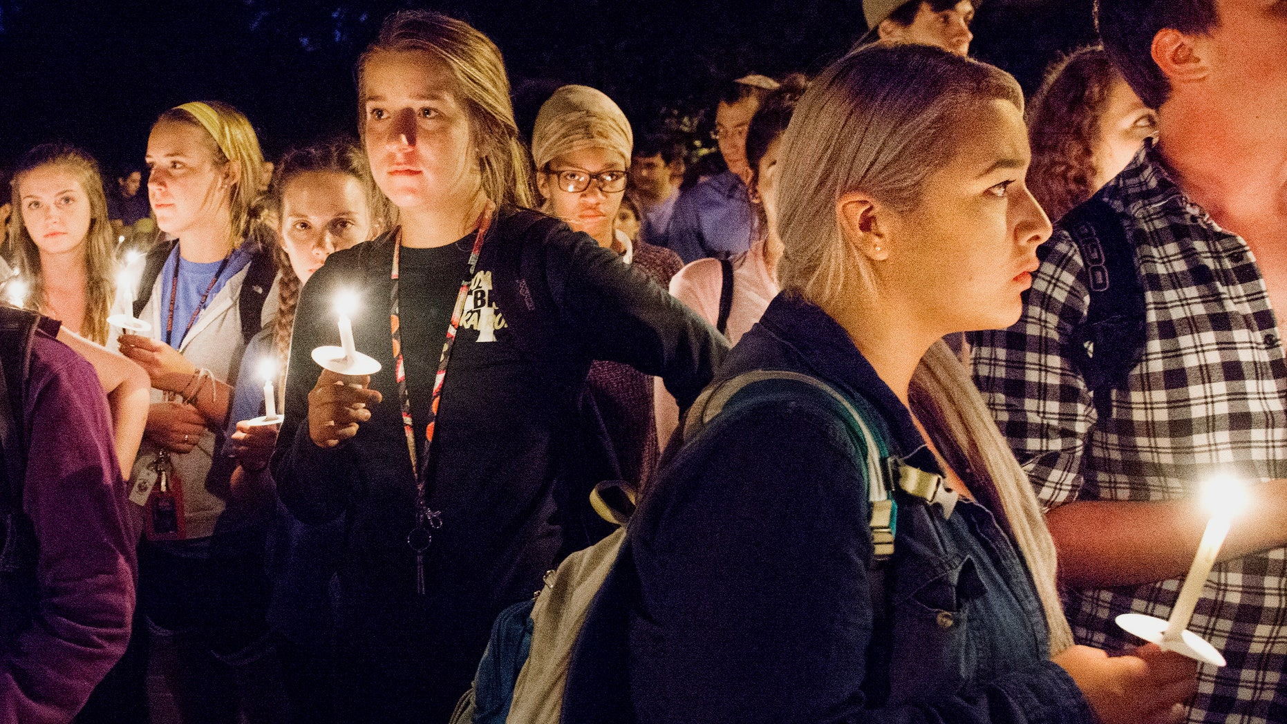 University of Illinois students attend a candlelight vigil in remembrance of the deadly shooting.