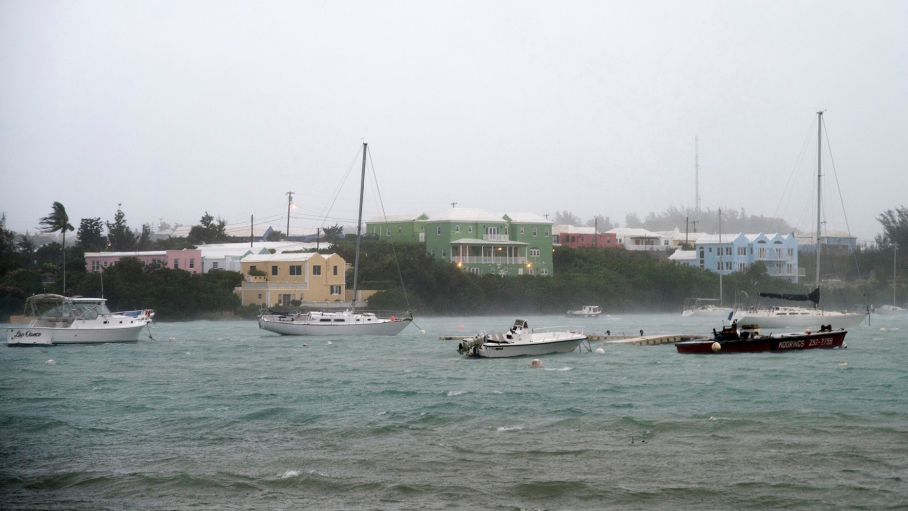 Heavy rain and strong winds rock boats moored in Mullet Bay in St. Georges, Bermuda, on Thursday.