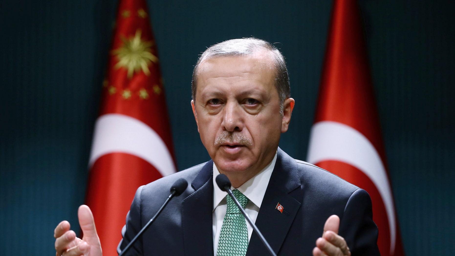 FILE -- Turkey's President Recep Tayyip Erdogan addresses a meeting in Ankara, Turkey.