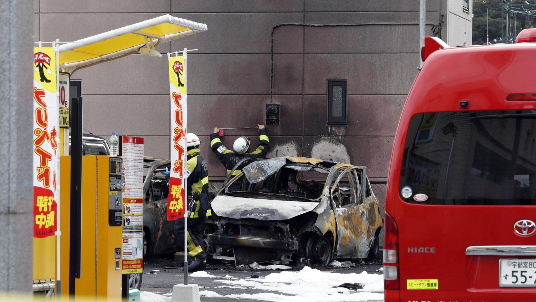 Firefighters investigating the scene in Utsunomiya, north of Tokyo.