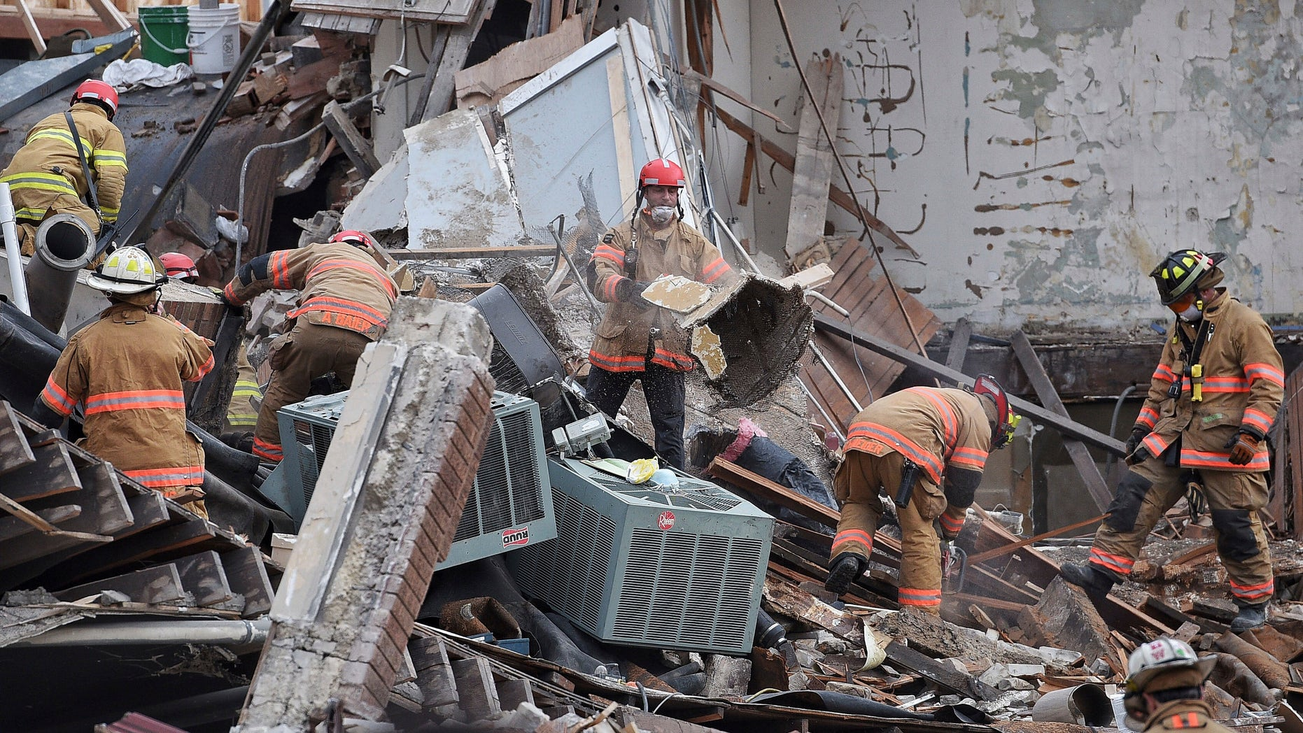 Emergency crews clear debris at the scene of the building collapse in Sioux Falls.