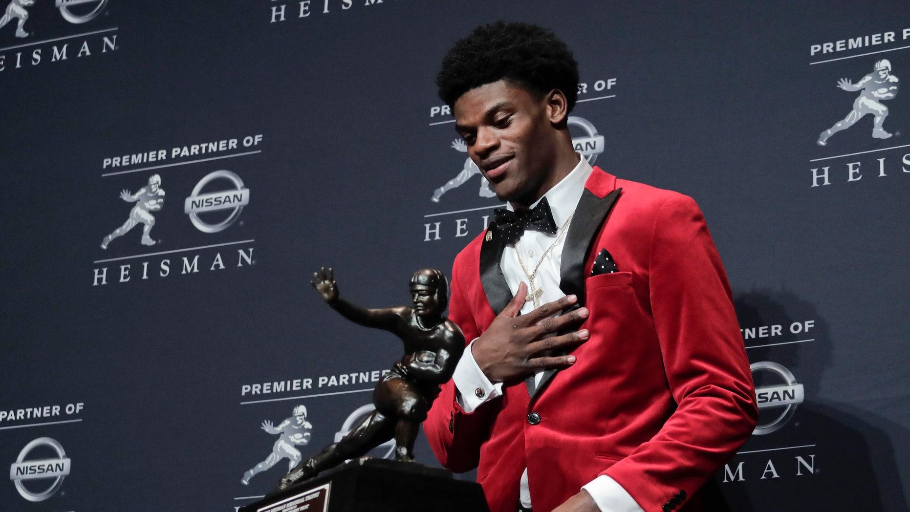 Louisville's Lamar Jackson winning the Heisman Trophy award Saturday.