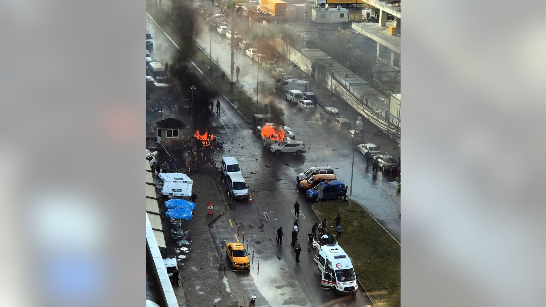 Cars burning after the explosion in Izmir.