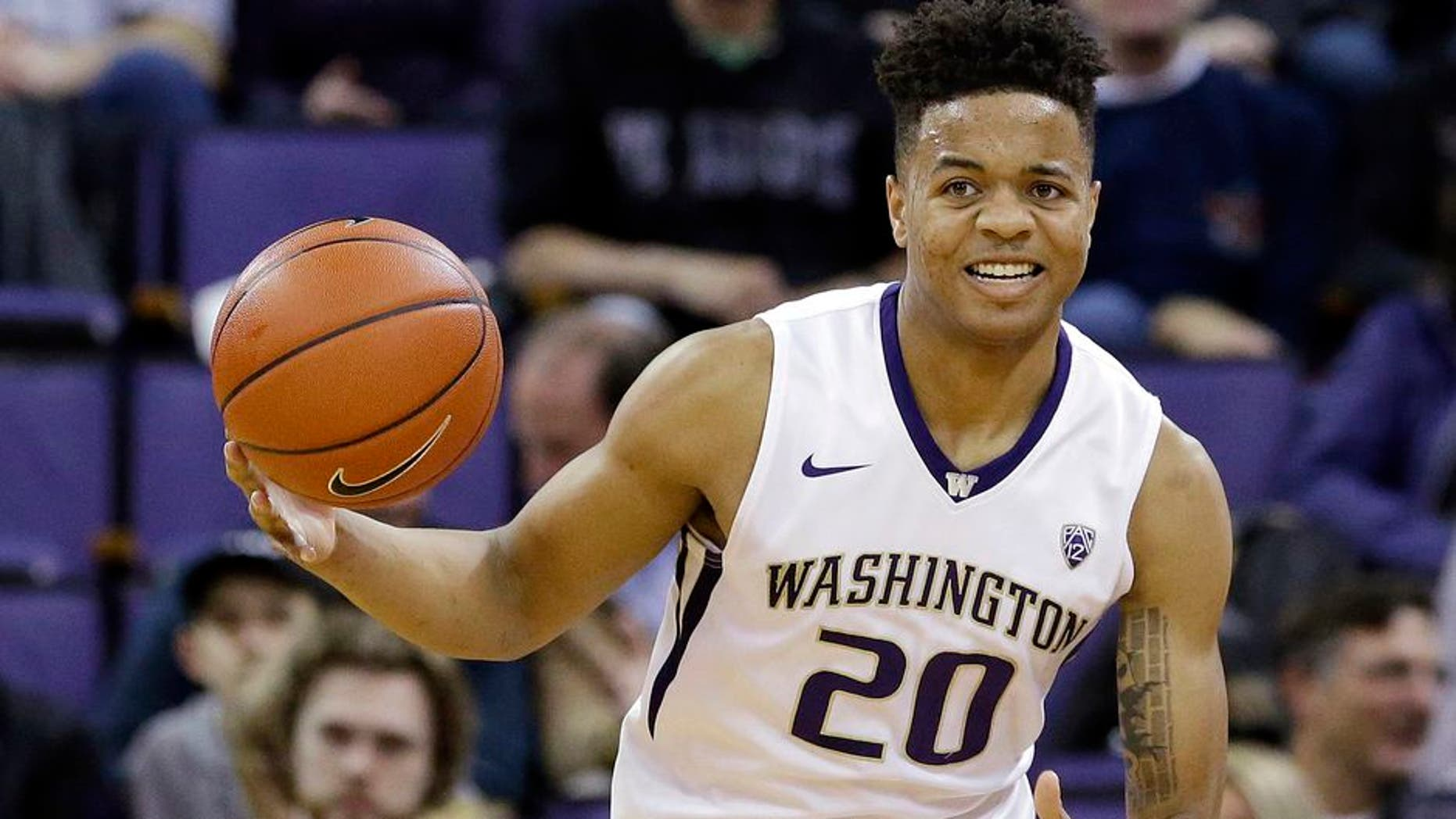 FILE - In this Feb. 18, 2017, file photo, Washington's Markelle Fultz brings the ball upcourt against Arizona during an NCAA college basketball game in Seattle. Fultz was selected to the AP All-Pac-12 Conference first team, Tuesday, March 7, 2017. (AP Photo/Elaine Thompson, File)