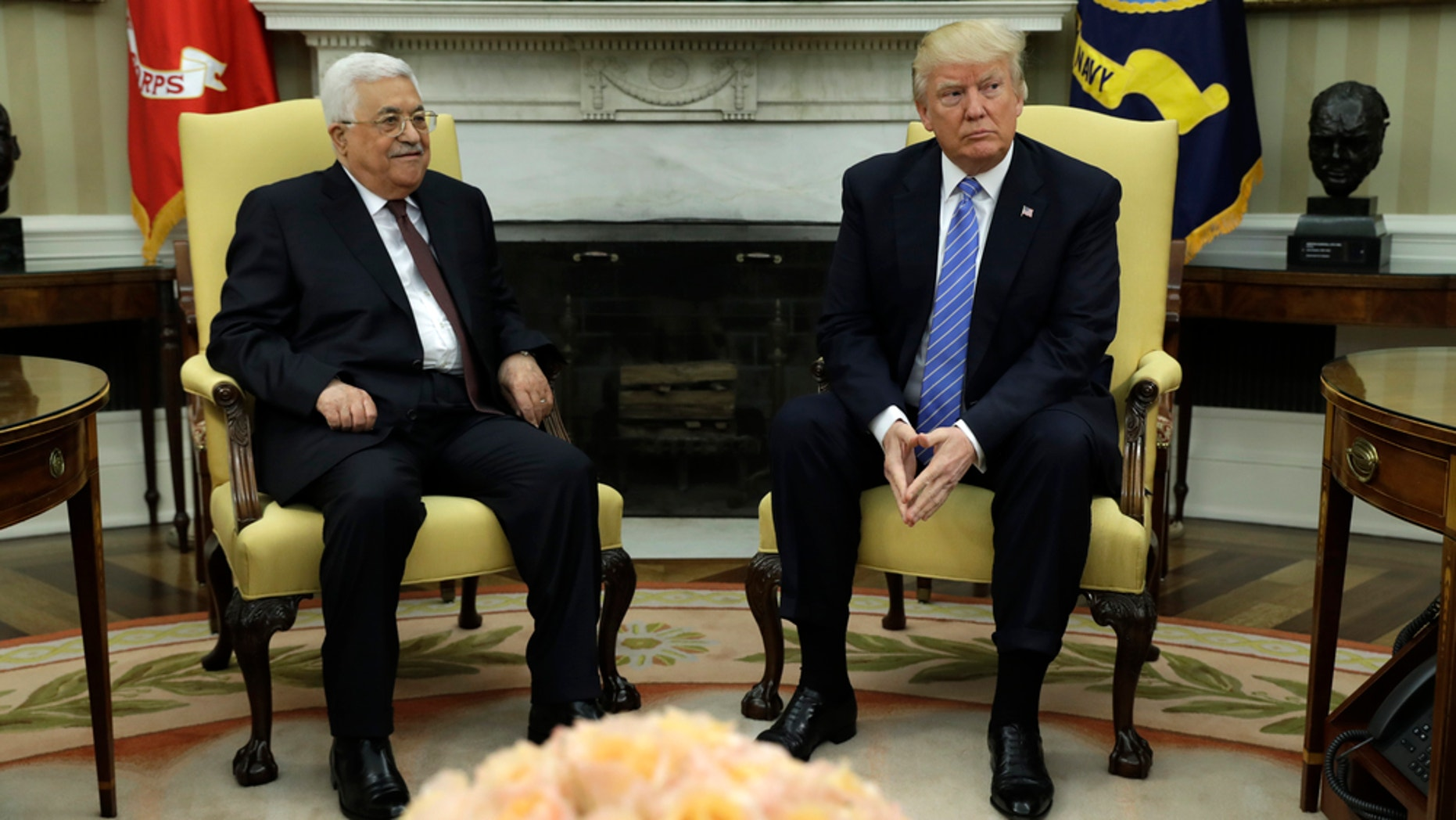 President Donald Trump is pictured with Palestinian leader Mahmoud Abbas at the White House earlier this month. Trump will meet Abbas in Bethlehem during his first foreign rip.