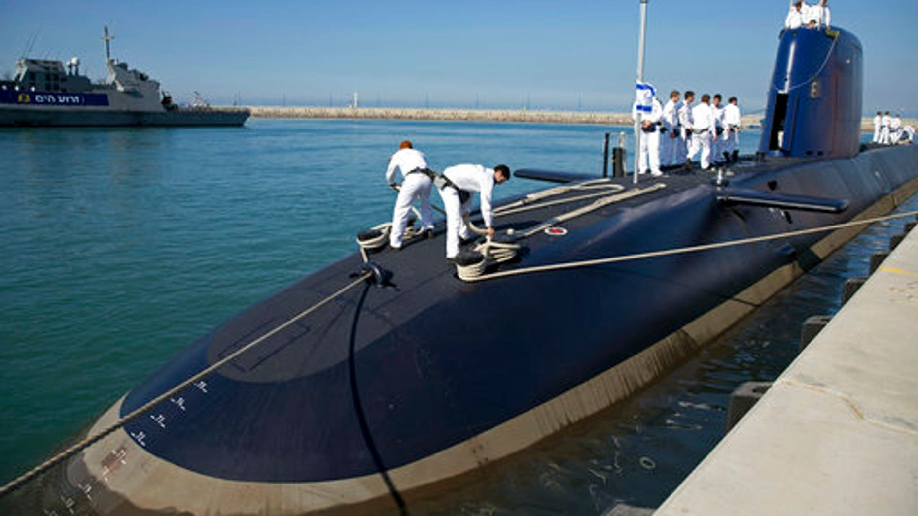 """Israeli sailors stand on a German-built """"Rahav"""" submarine on its arrival in to the military port in Haifa, Israel, in January 2016."""