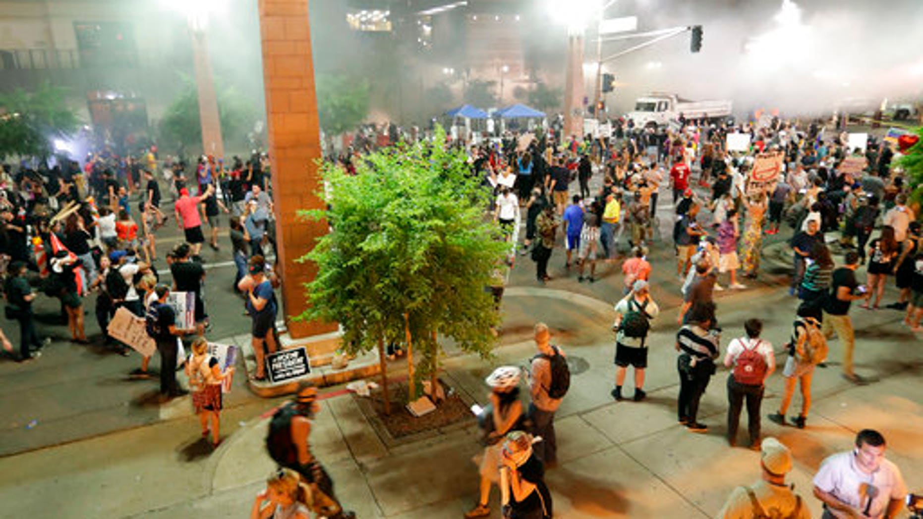 Protesters outside the Phoenix Convention Center on Tuesday.