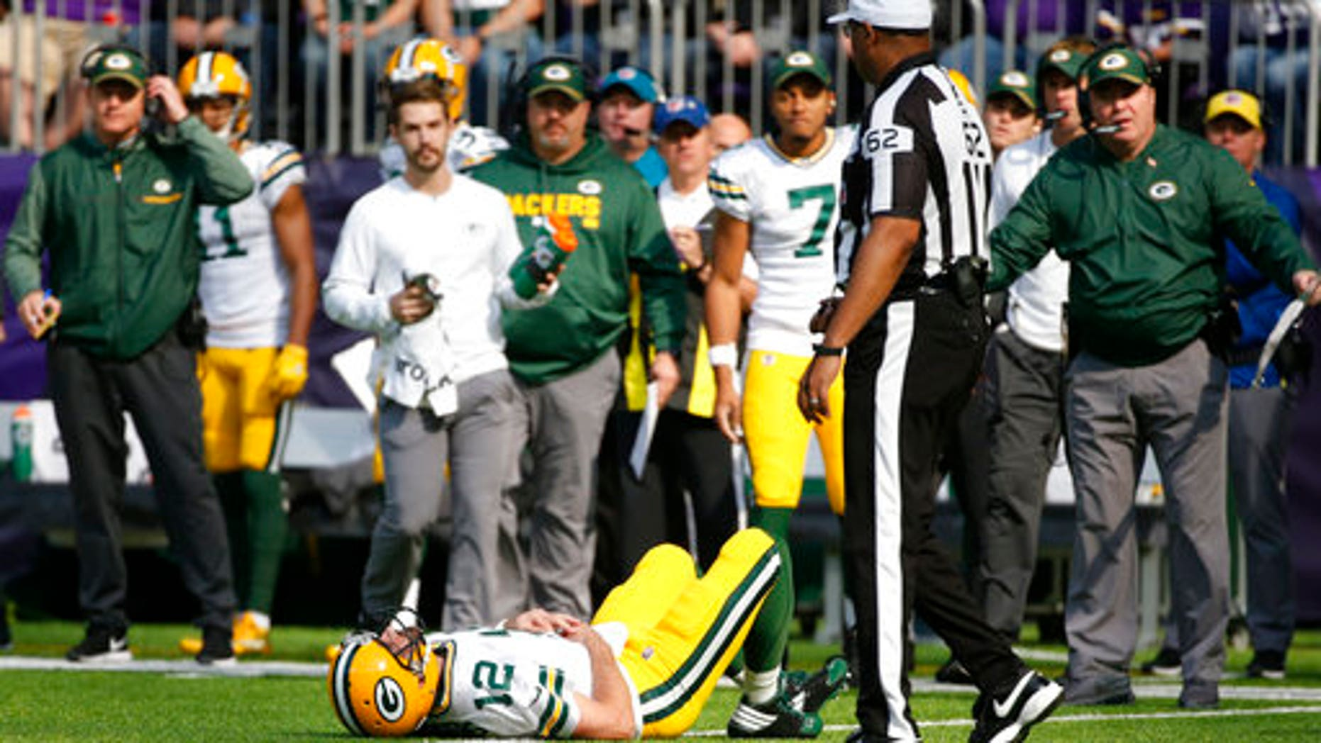 Green Bay Packers quarterback Aaron Rodgers (12) lies on the ground after  being hit ed640c628