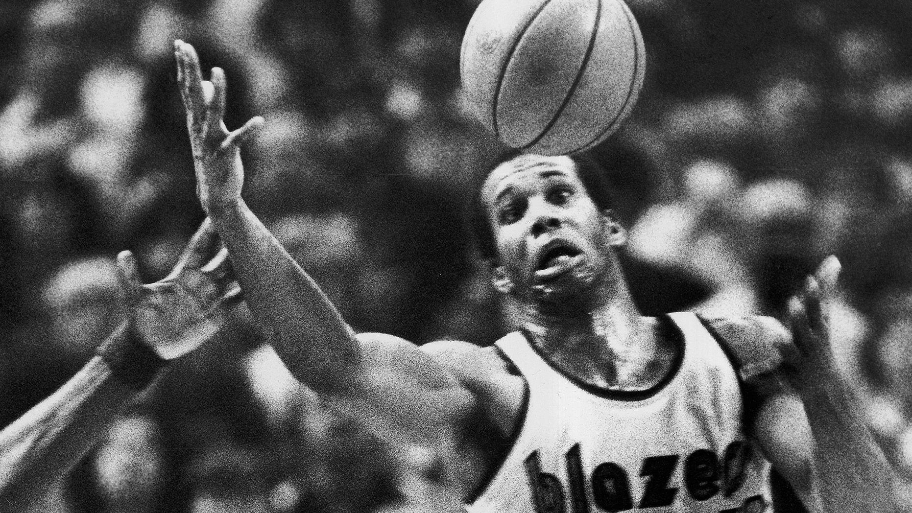 The Portland Trail Blazers' Kermit Washington gaining control of a loose ball in 1979.