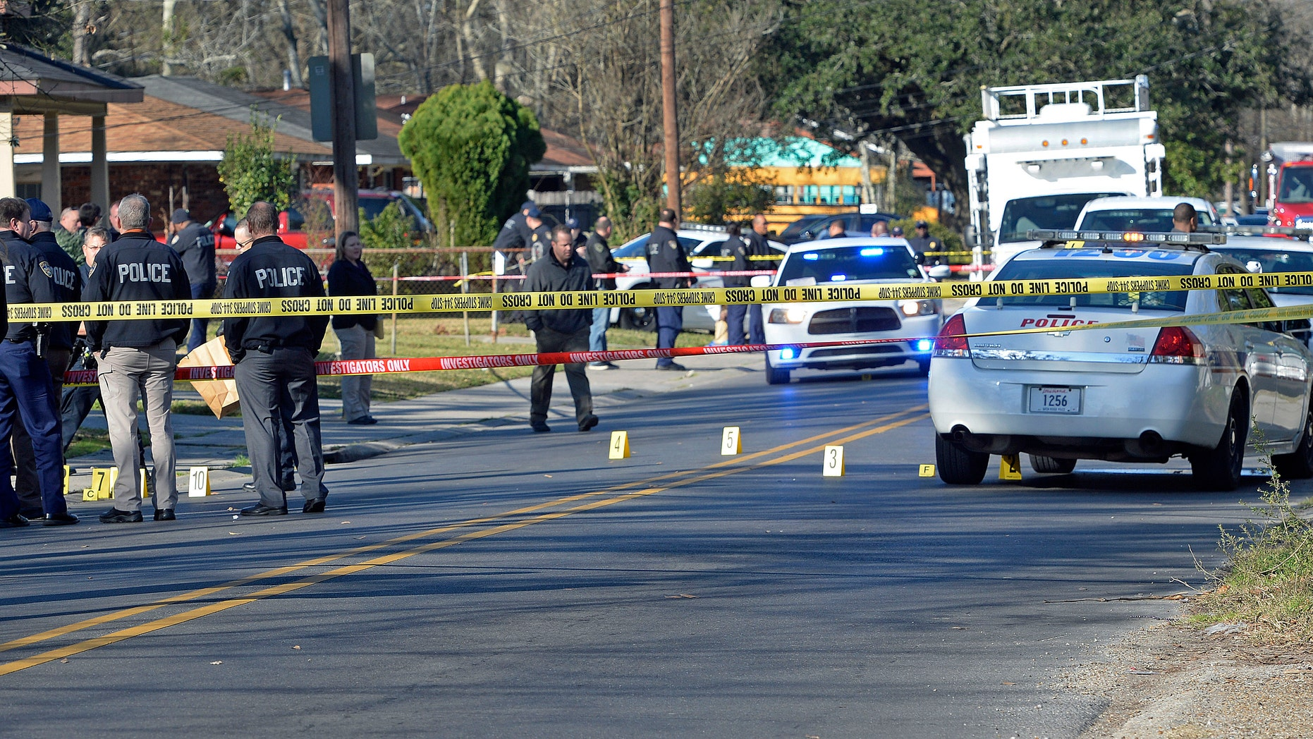 Officers investigating the shooting scene on Saturday.