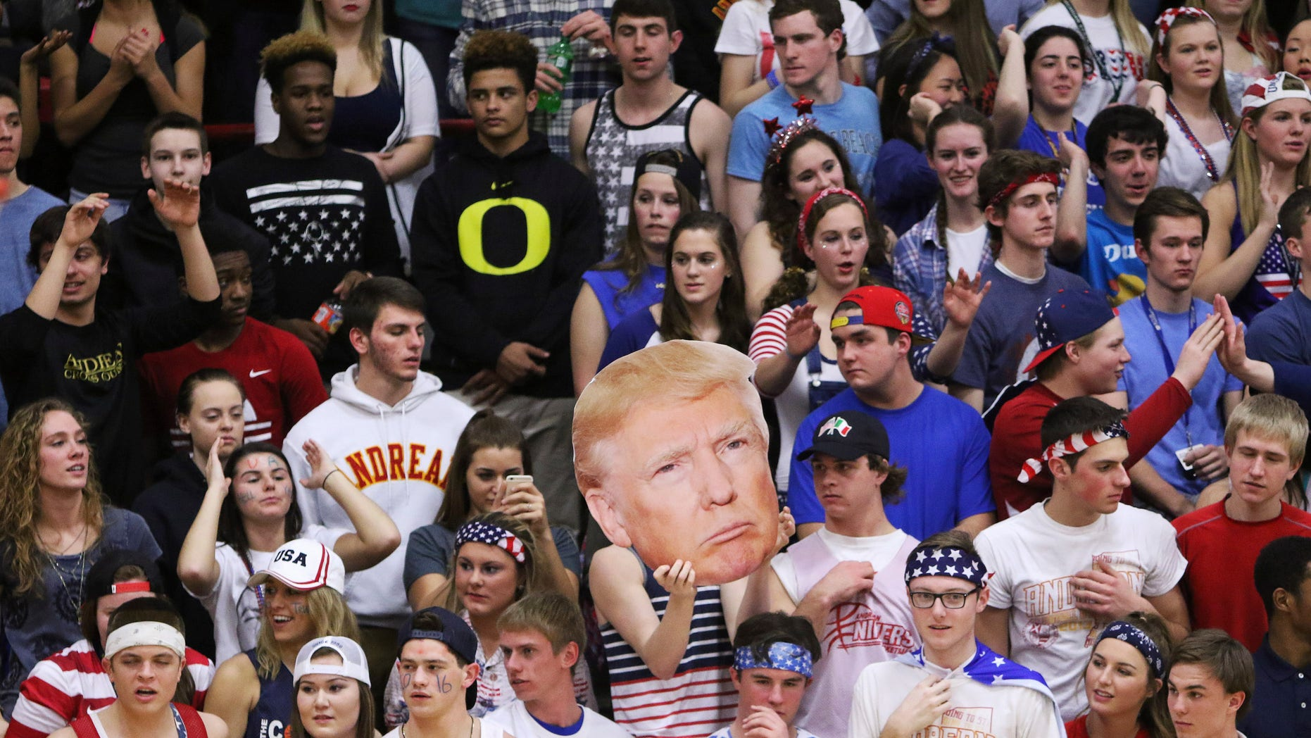 The Andrean High School student section holds up a picture of GOP presidential candidate Donald Trump during their school's basketball game against Bishop Noll Institute Friday.