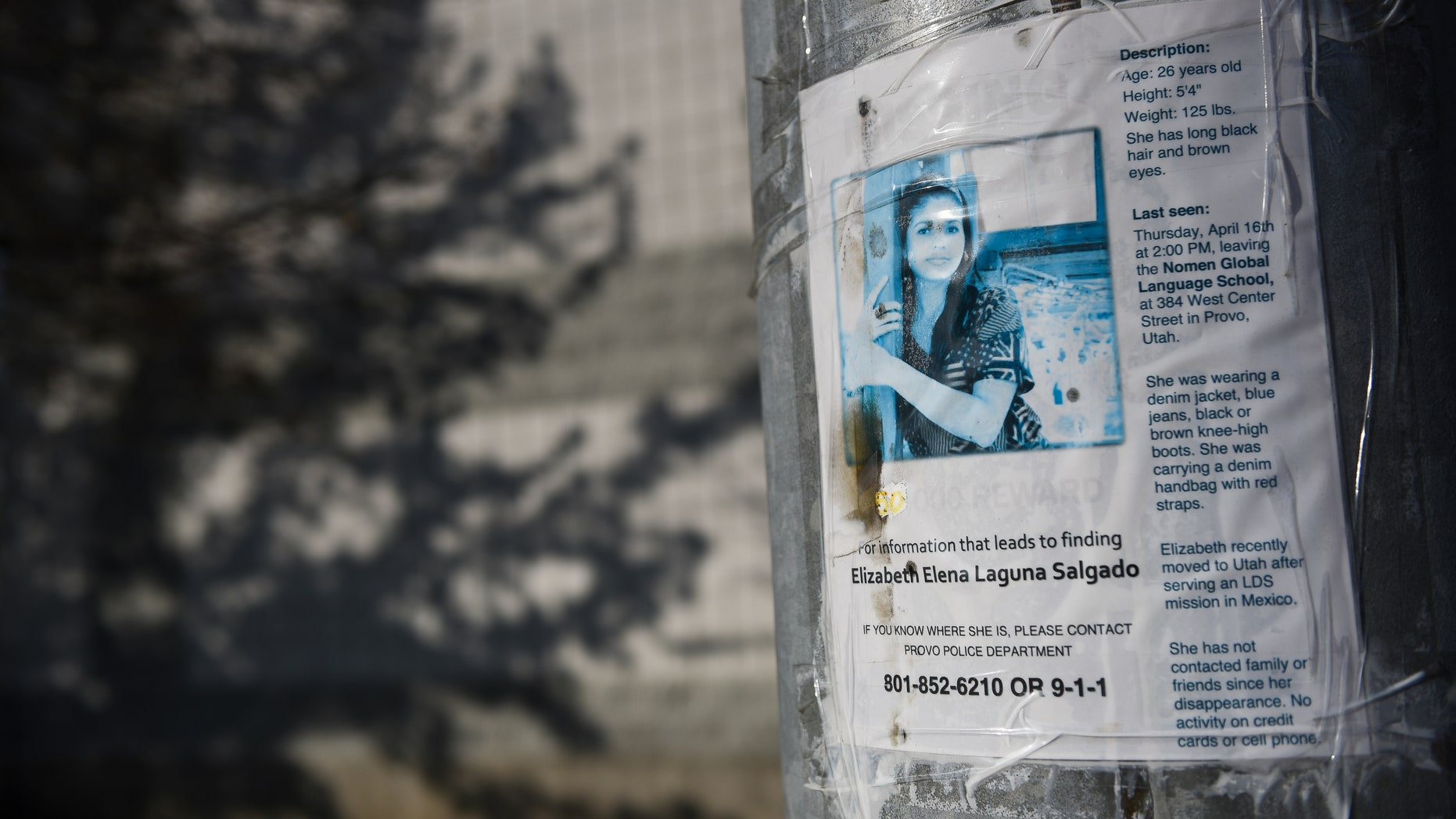 A poster seeking information about missing woman Elizabeth Elena Laguna Salgado in Provo.