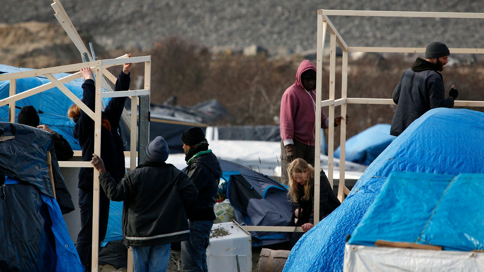 """A makeshift camp for migrants near Calais, France. A French court approved razing tents at a camp known as the """"jungle."""""""