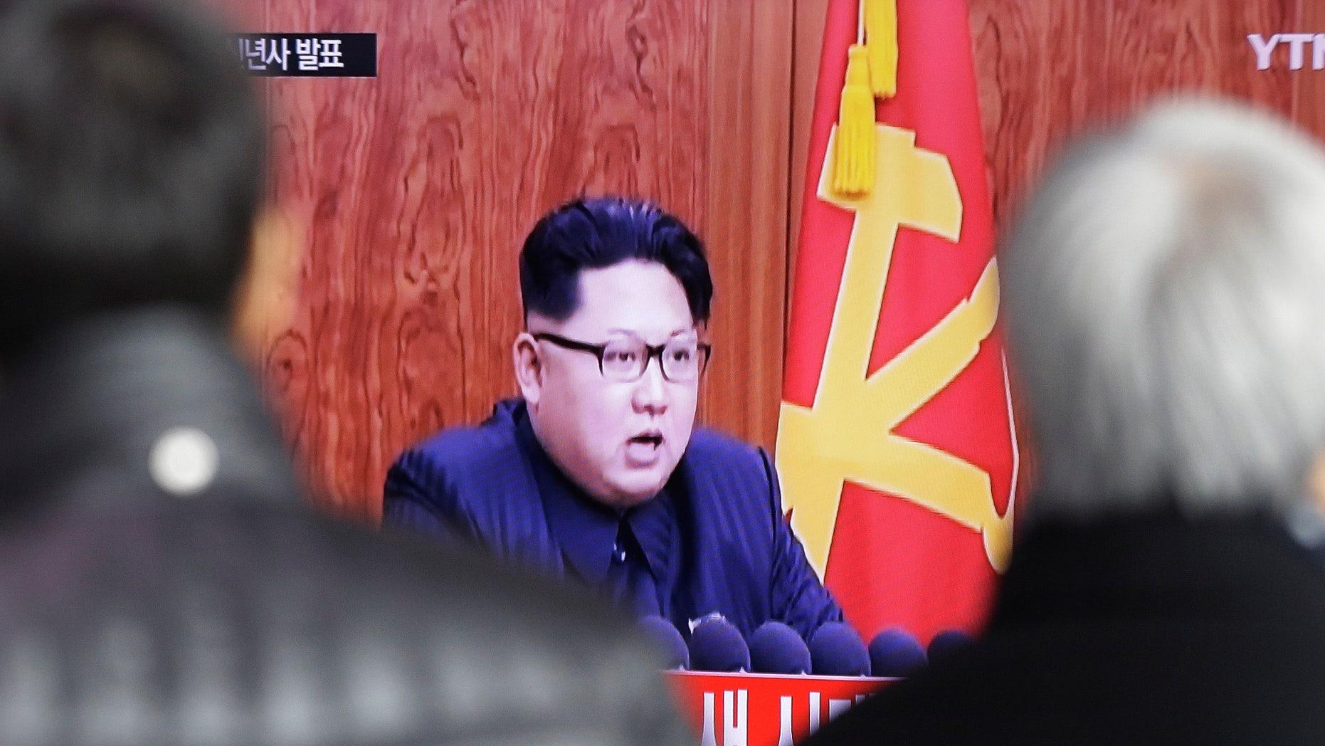 South Koreans watch a TV news program showing North Korean leader Kim Jong Un's New Year speech, in Seoul.