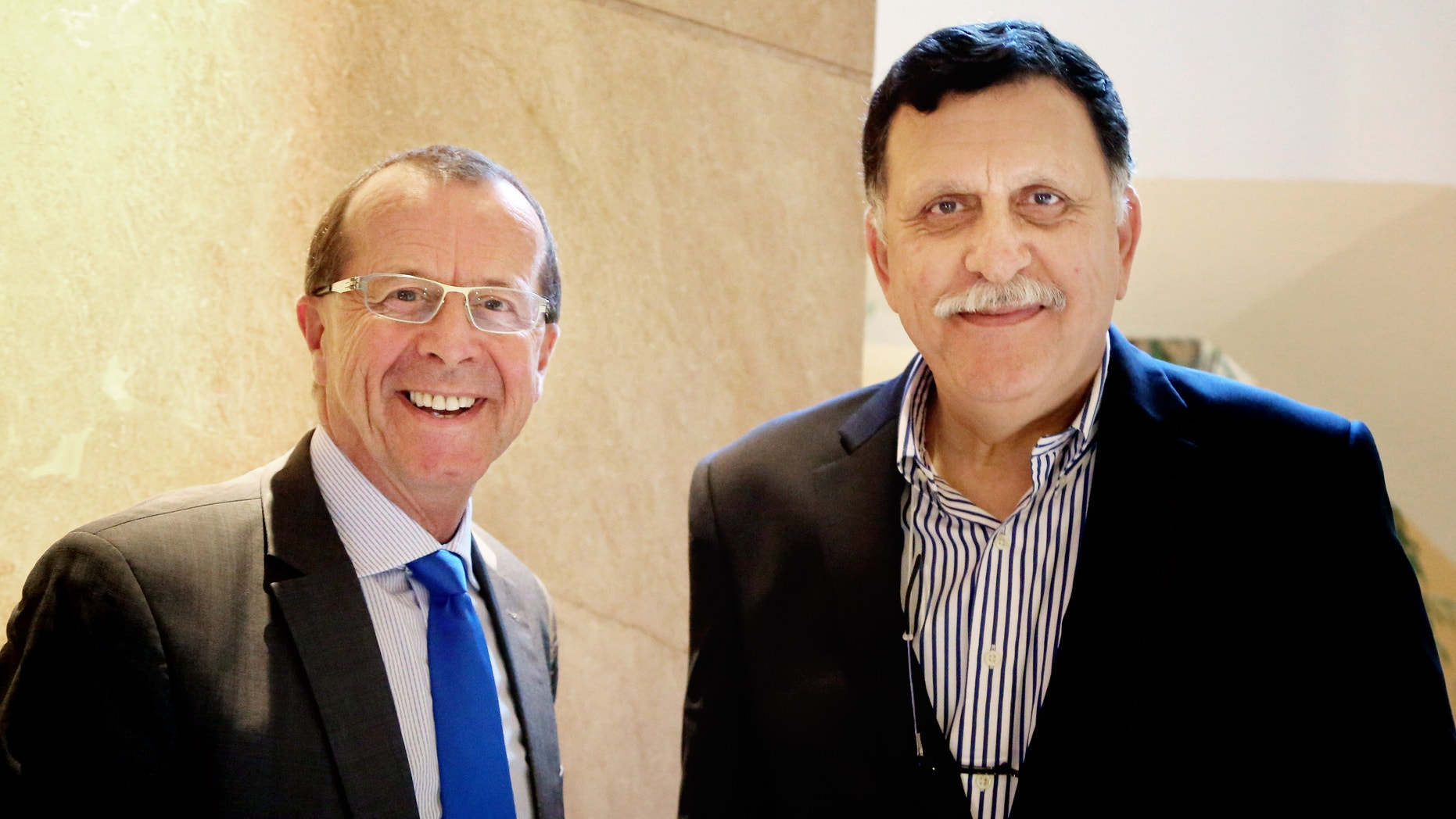 U.N. special envoy for Libya Martin Kobler, left, is greeted in Cairo by Fayez Serraj, Libyan designated-prime minister and head of the presidential council, in February.