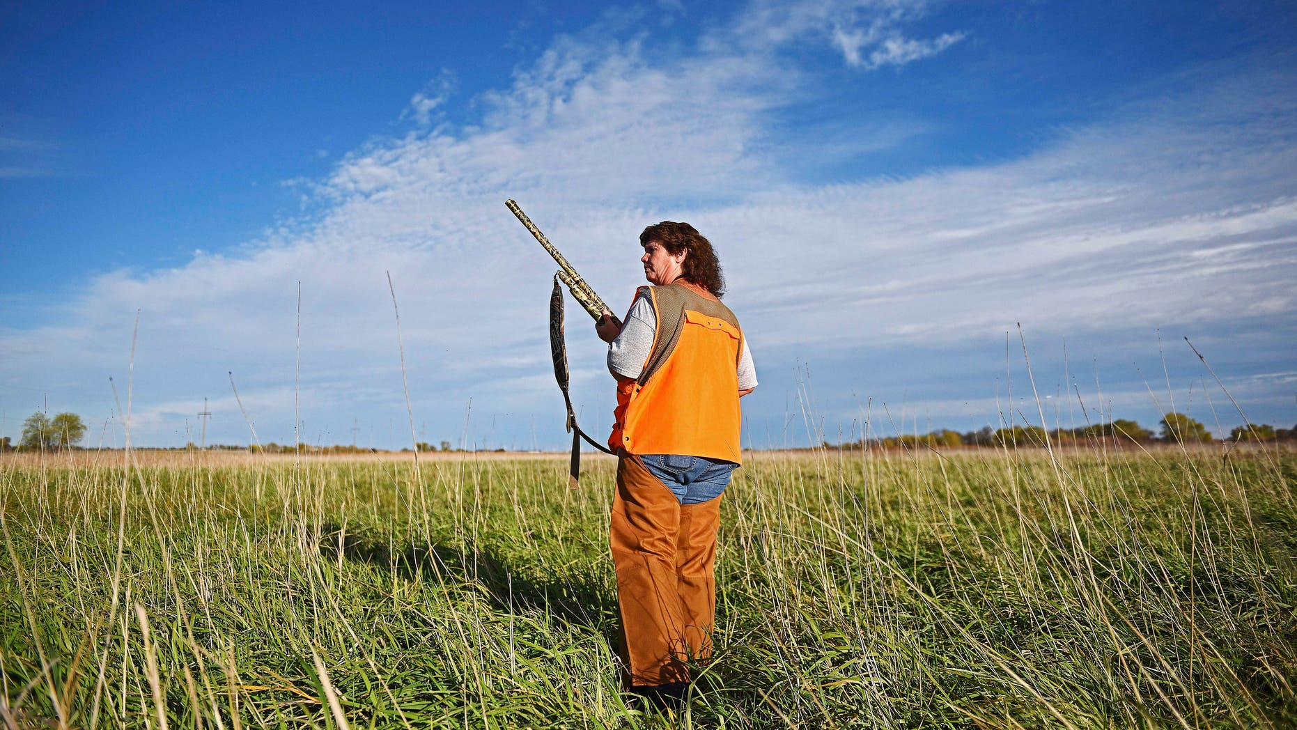 Carol Bothe, of Brandon, S.D., walks a piece of cover during the South Dakota pheasant hunting opener while on her family's farm near Brookings.