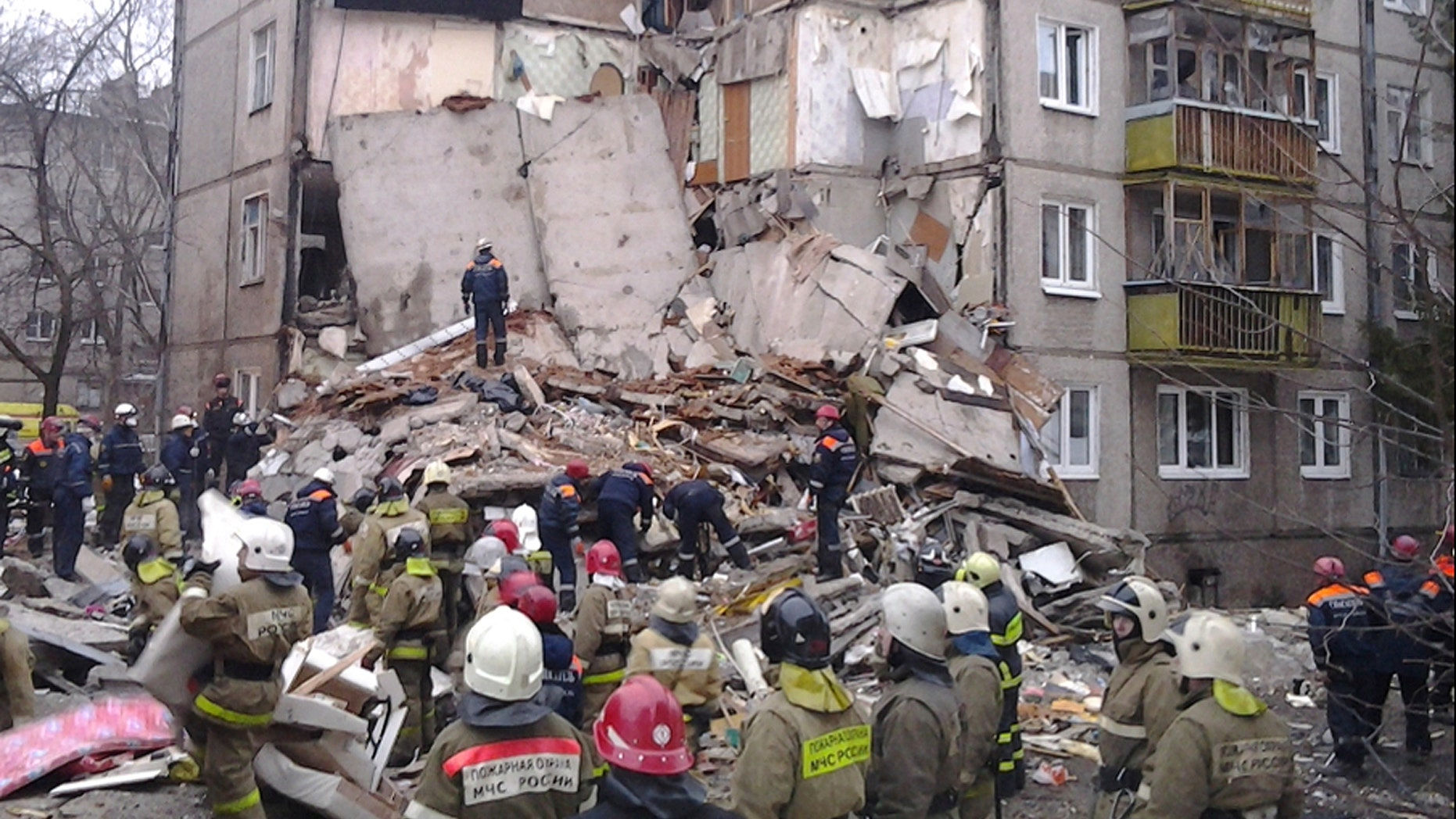 In this photo provided by the Yaroslavl Branch of Russian Emergency Ministry Press Service, emergency and rescue workers search the debris of a 5-story apartment building after a powerful natural gas explosion early Tuesday, Feb. 16, 2016, in Yaroslavl, Russia. (Russian Emergency Ministry Yaroslavl Branch Press Service via AP)