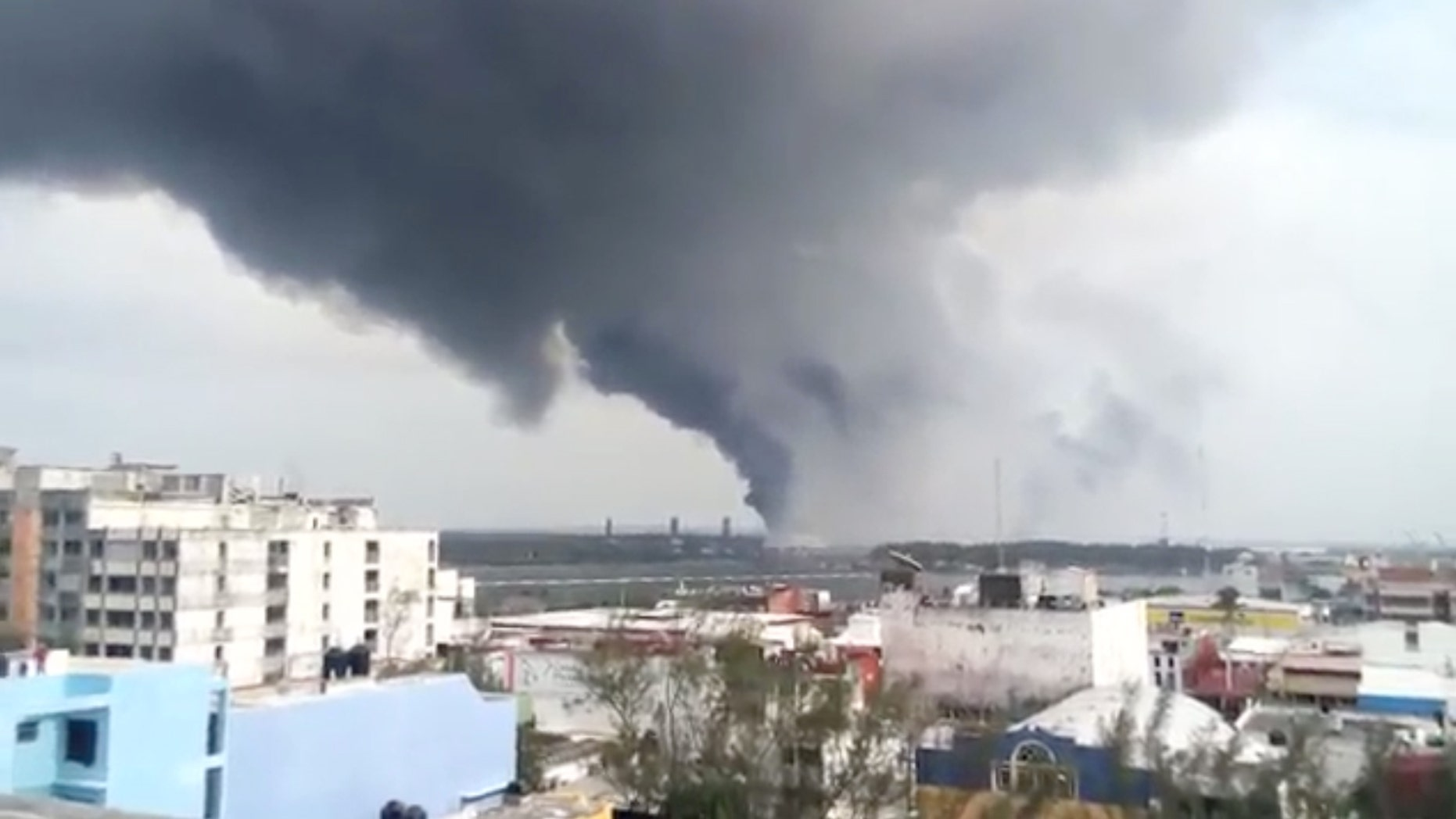 BEST QUALITY AVAILABLE - In this video grab a large plume of smoke rises from the Mexican State oil company Petroleos Mexicanos' petrochemical plant after an explosion in Coatzacoalcos, Mexico, Wednesday, April 20, 2016. The explosion killed several people, injuring dozens and sending flames and a toxin-filled cloud into the air, officials said. (Omar Diaz/Oaxaca Integro via AP)
