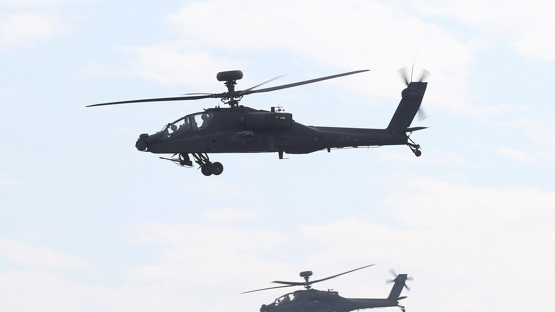 AH-64E Apache attack helicopters which are equipped with AN/APG-78 Longbow Fire Control Radar and purchased from the U.S. take part during a commissioning ceremony at the Tainan military base in Tainan, southern Taiwan.