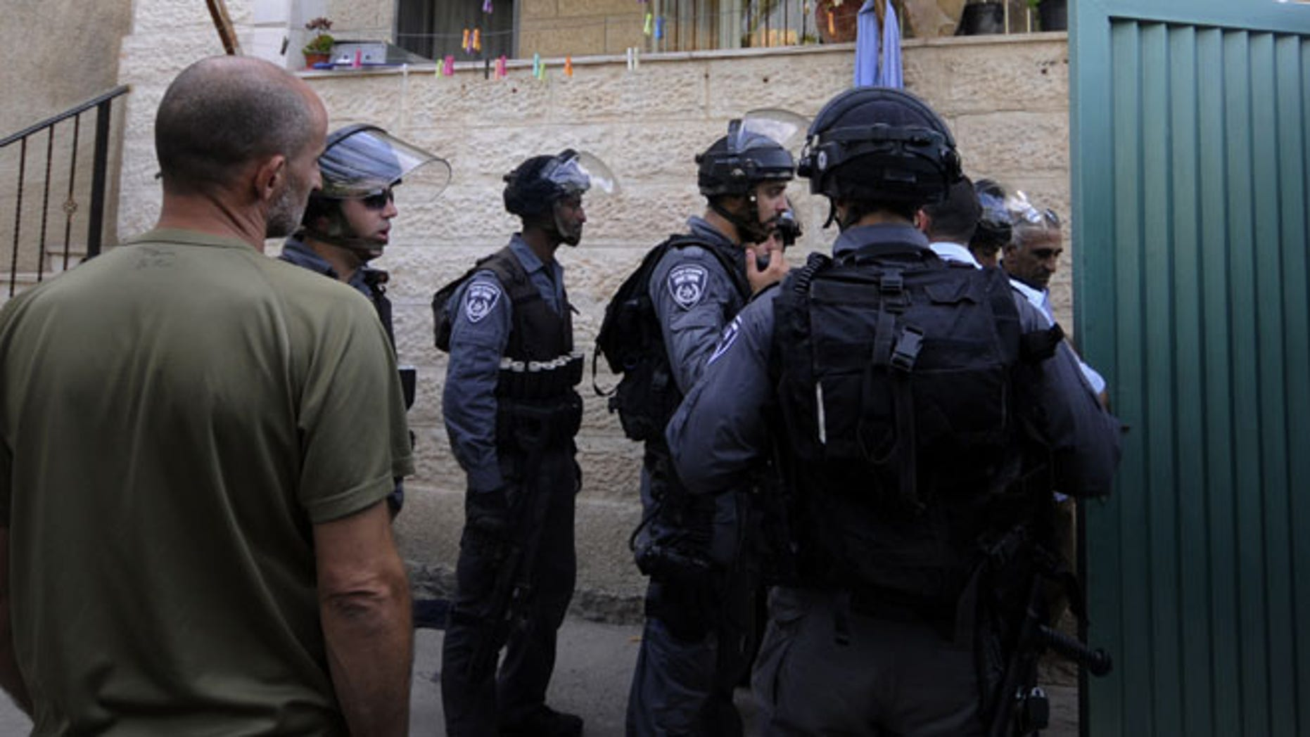 Sept. 30, 2014: Israeli police officers guard the house of Ziad Qarain, that Jewish settlers moved into, at the Palestinian neighborhood of Silwan, East Jerusalem