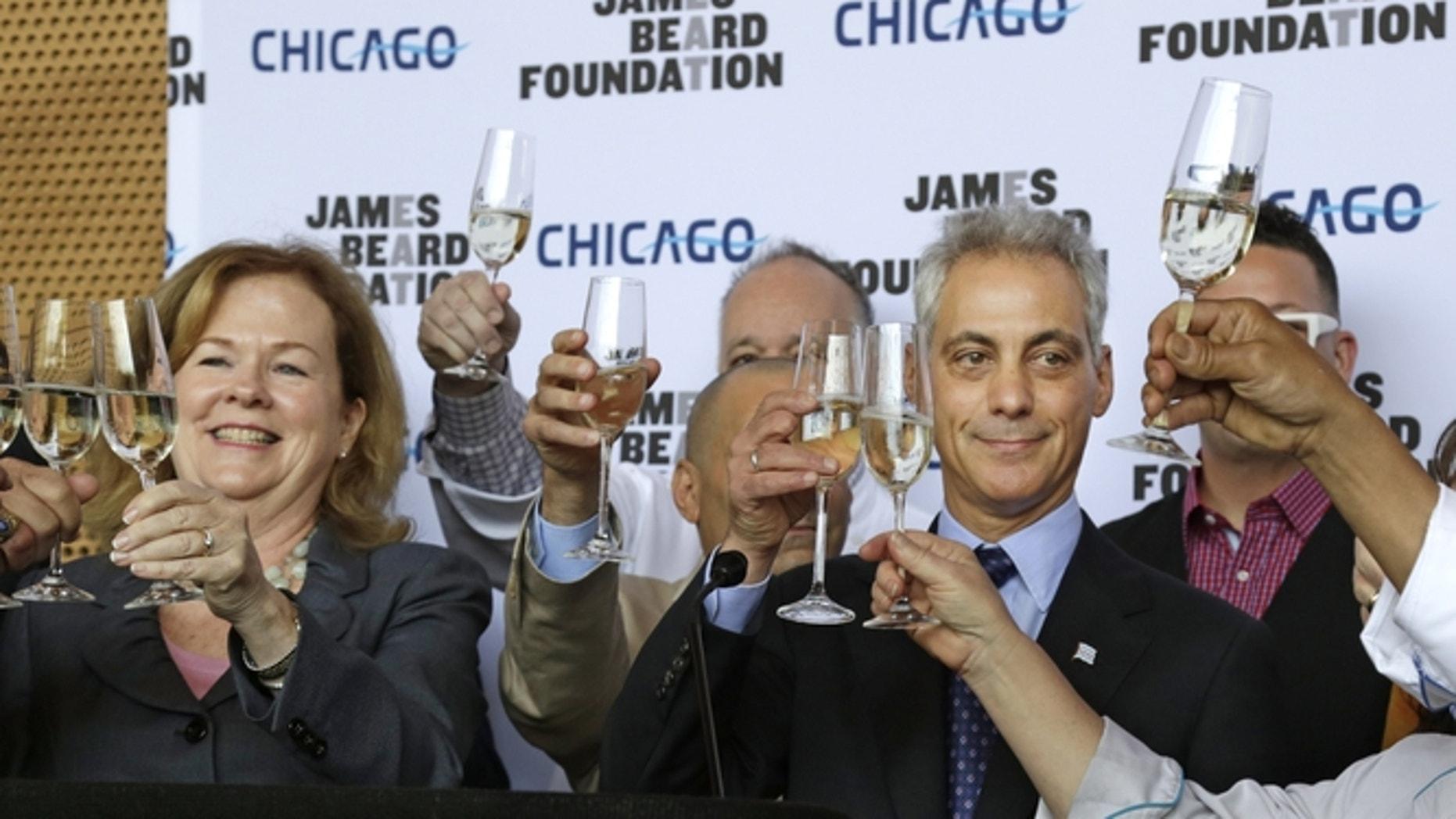 Susan Ungaro, President of the James Beard Foundation, left, and Chicago Mayor Rahm Emanuel, right, toast to the JBF Awards.