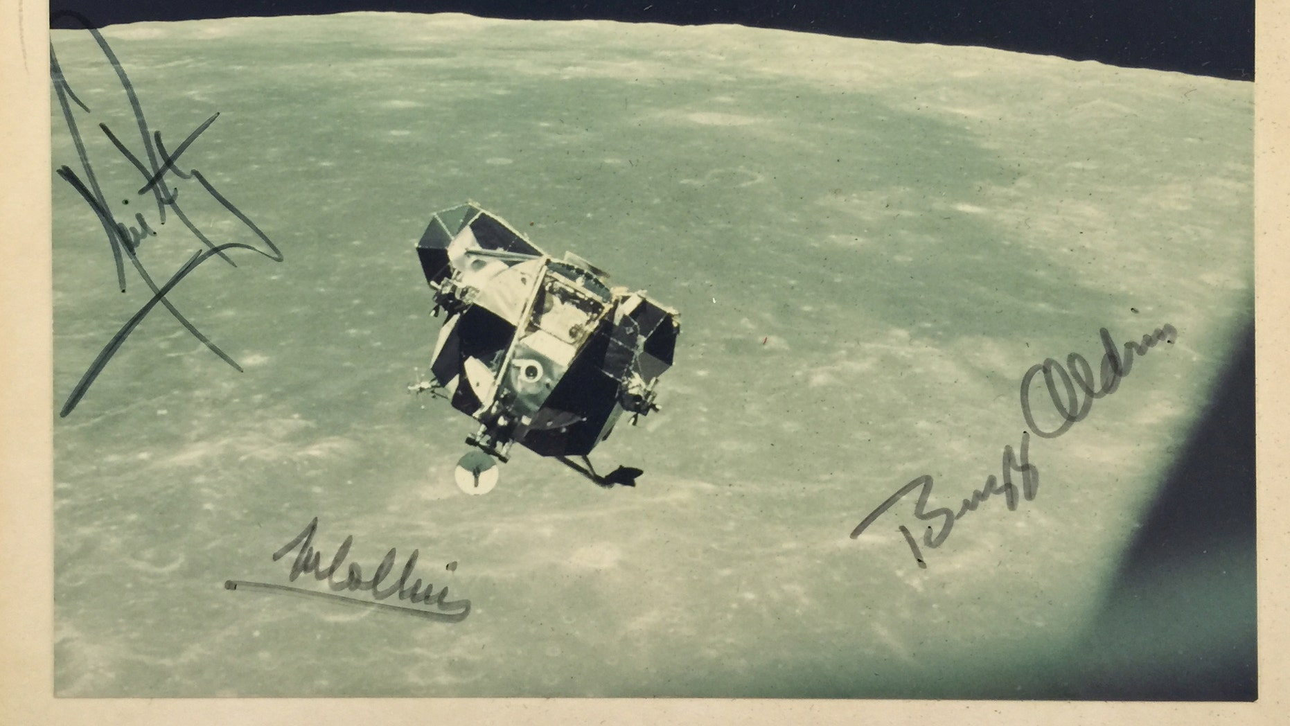 The signed moon landing photo (Henry Aldridge and Son).