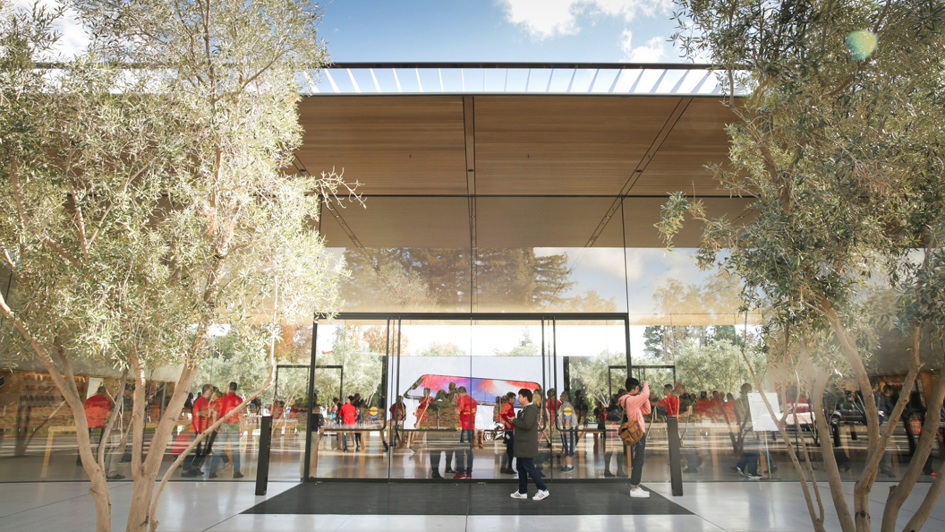 Apple was happy to share during development that it was using the world's largest panels of curved glass, but glass is clear and therefore quite hard to see when you're walking about.