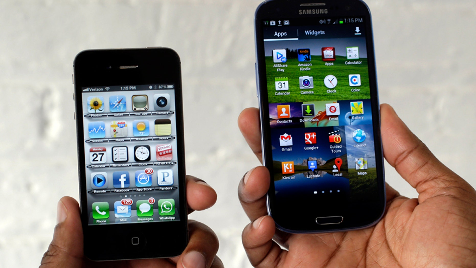 In this Aug. 27, 2012 photo, the Apple iPhone 4s, left, is displayed next to the Samsung Galaxy S III at a store in San Francisco.