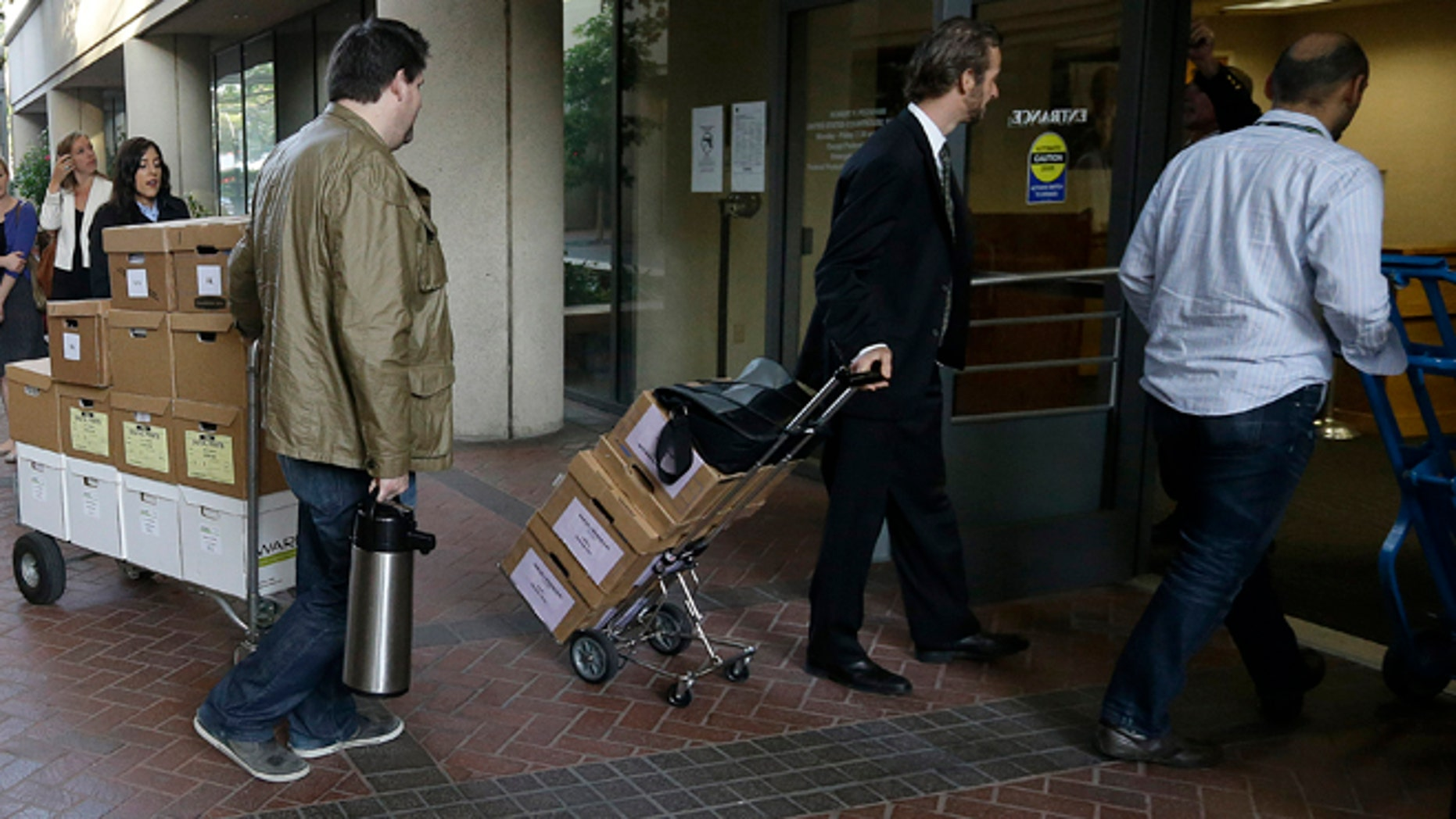 April 29, 2014: Boxes containing documents related to the Apple Inc. v. Samsung case are taken into a federal courthouse in San Jose, Calif.