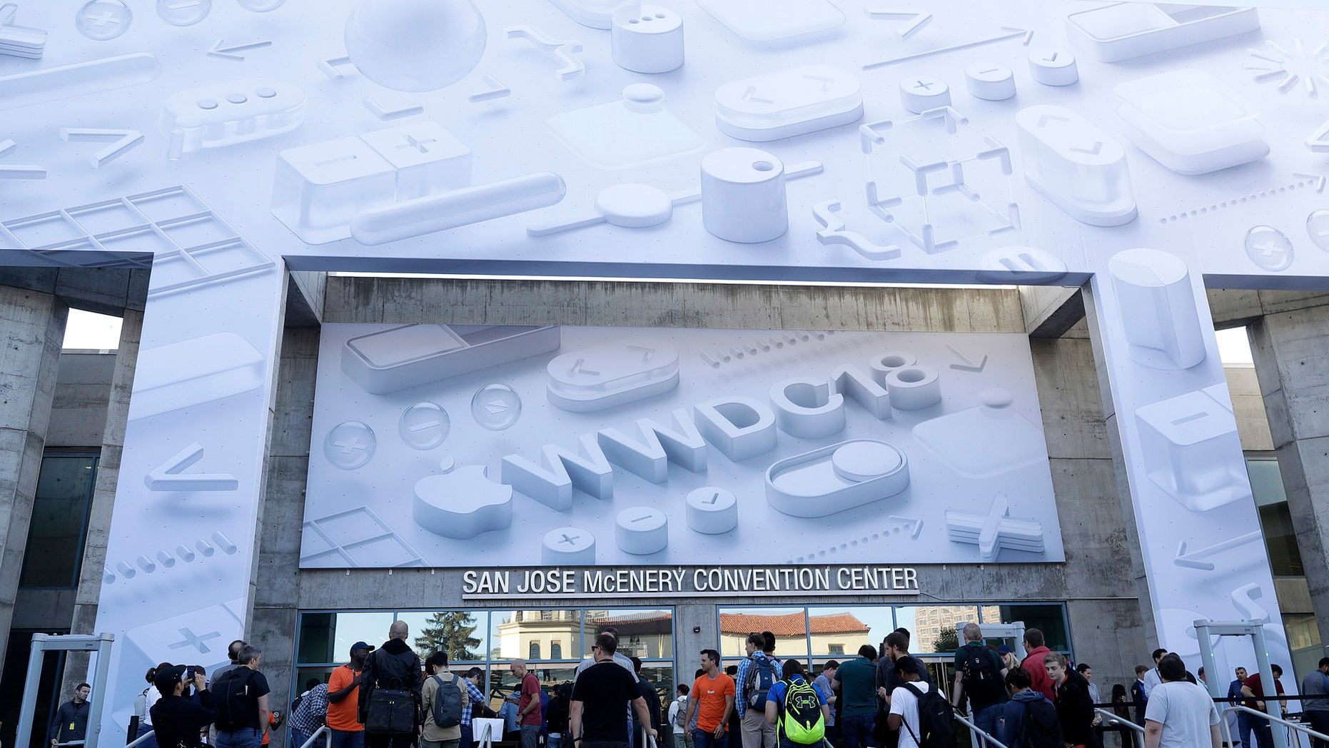 Attendees line up outside of the McEnery Convention Center for the Apple Worldwide Developers Conference in San Jose, Calif., Monday, June 4, 2018. (AP Photo/Marcio Jose Sanchez)