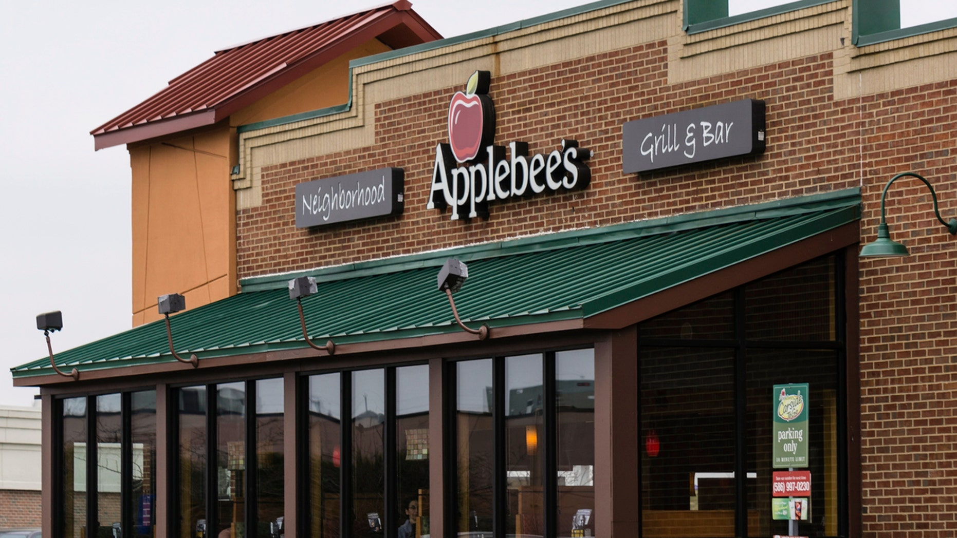 Shelby Township, Michigan, USA - March 23, 2016: People in an Applebee's restaurant in Shelby Township. Applebee's is a chain of casual dining restaurants with locations across the United States.